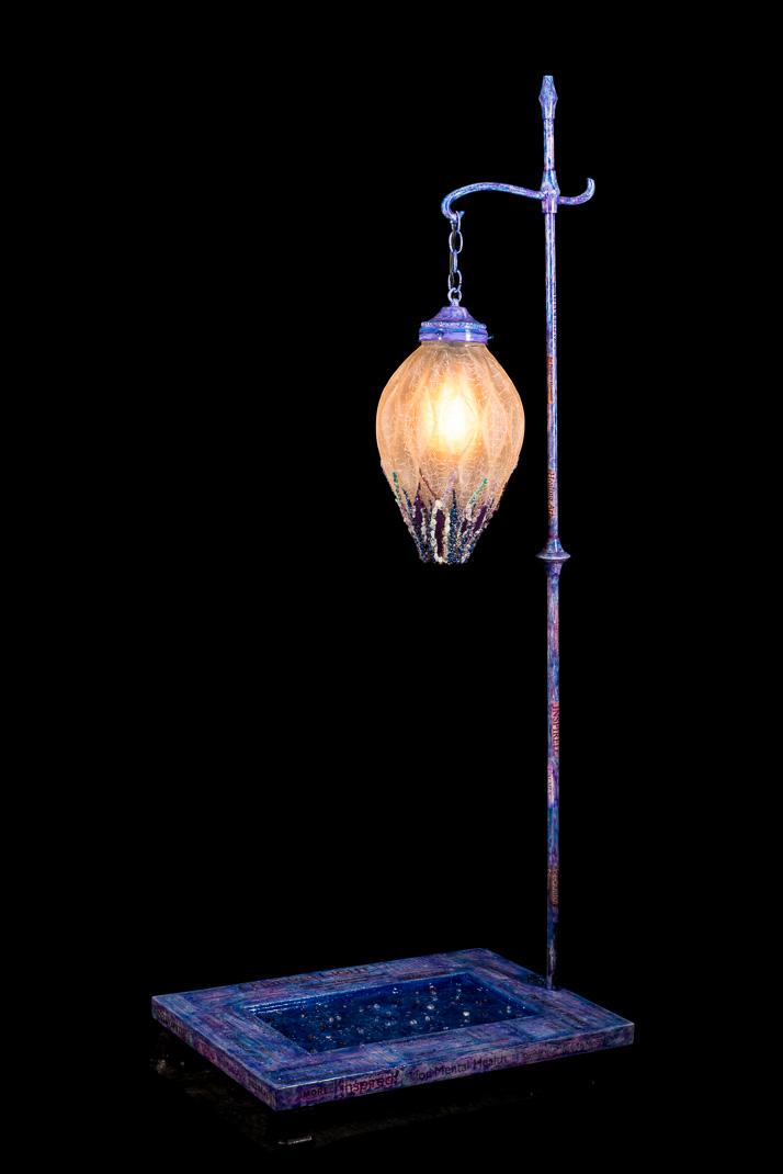 REFLECTIONS  mixed media piece with vintage lamp globe, door, acrylic, paper, amethyst, rose quartz, lapis lazuli, clear quartz, garnetand aquamarine  photo by Mark Hammon