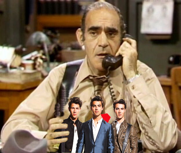 JONAS AND THE GREAT BIG FISH:  That's the jonas brothers in the hand of fish, a character on barney miller played by abe vigoda