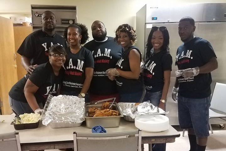 Young Adult Ministry members working in the kitchen.