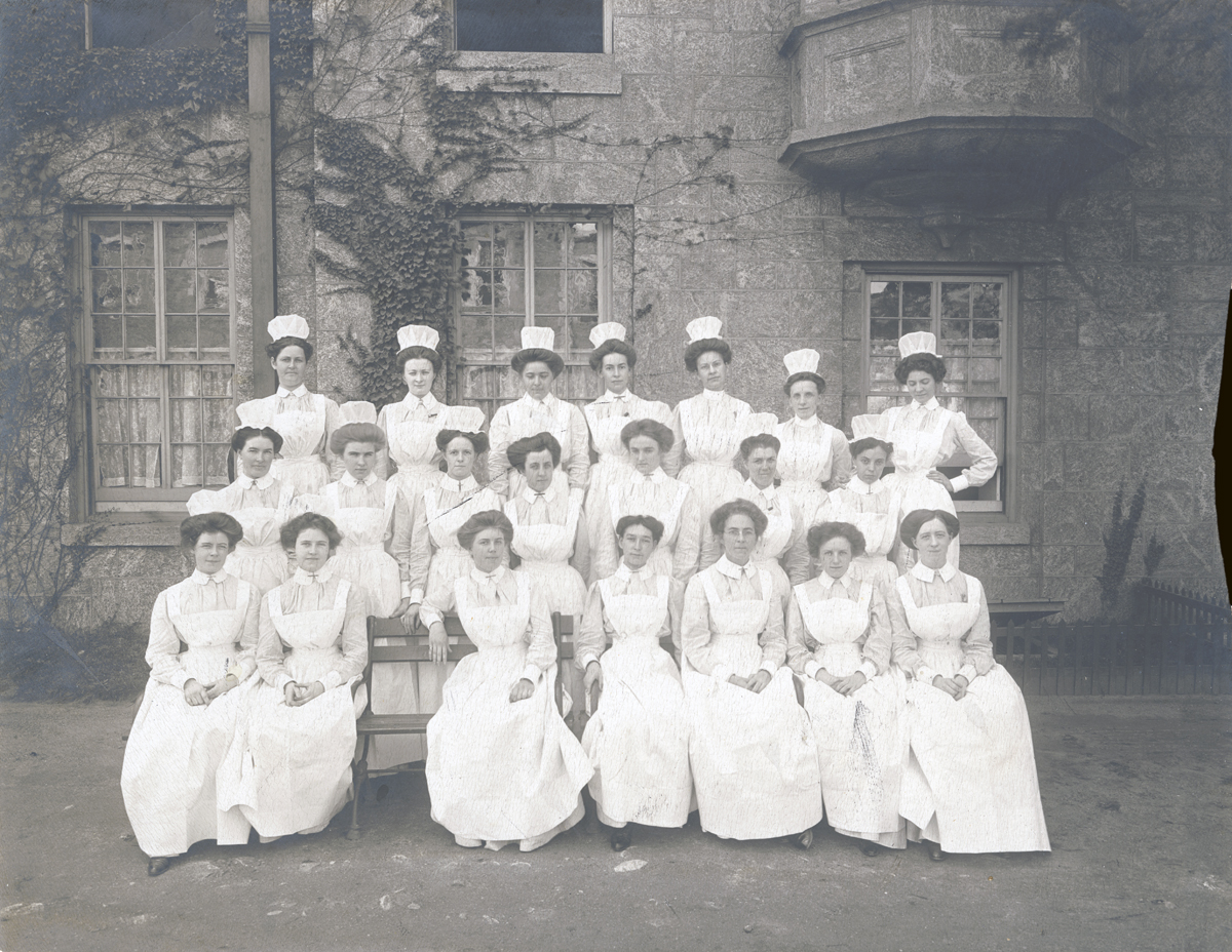 A class of nurses in front of the one of the building's oriel windows, New York City Municipal Archives