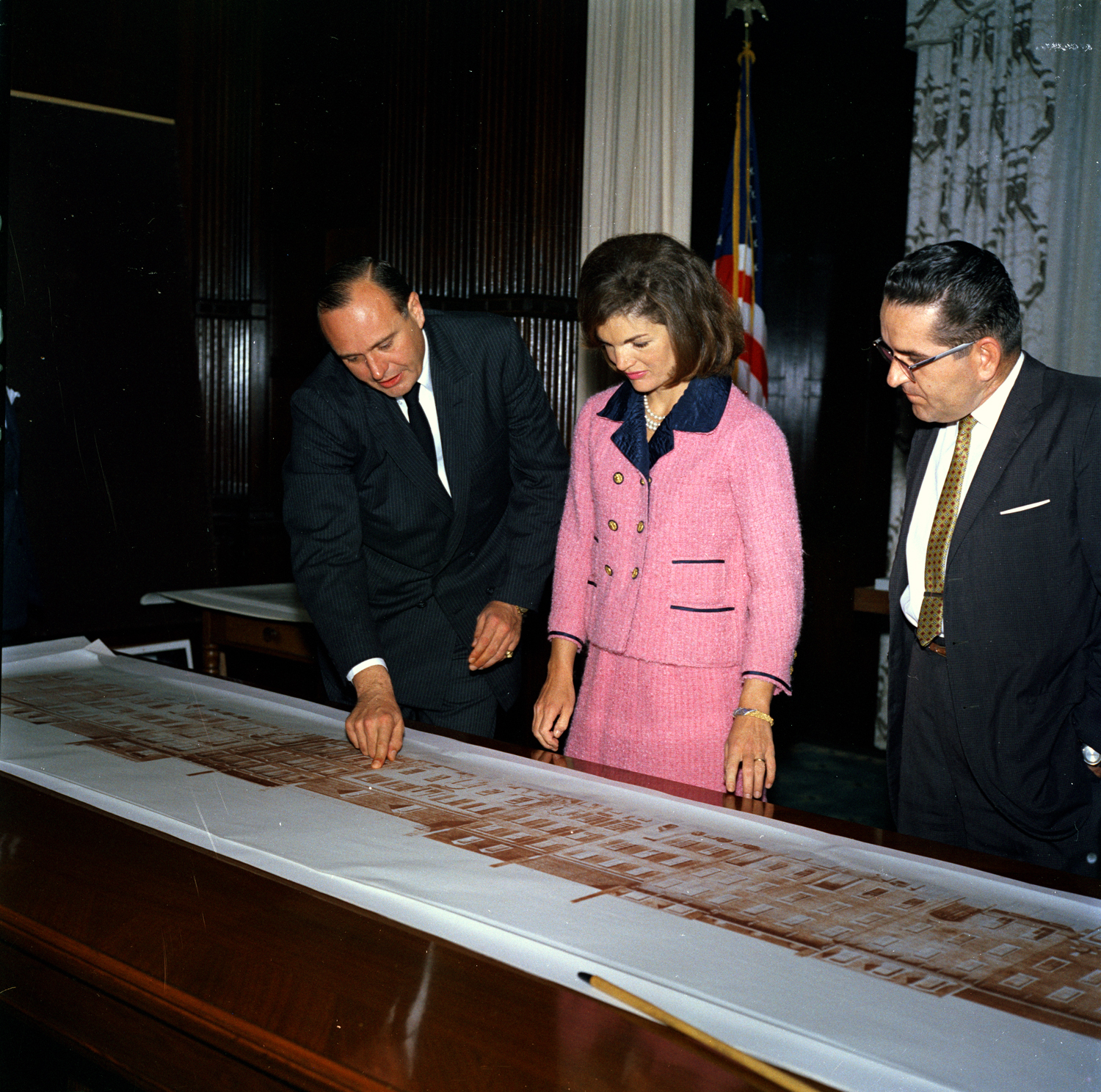 Jacqueline Kennedy reviews architectural elevations of the Renwick Gallery, John F. Kennedy Presidential Library