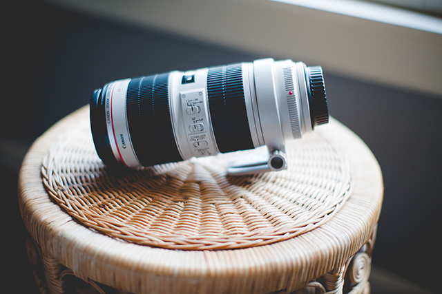 This is the Canon 70-200mm f/2.8L II lens. I have rarely used this lens but I could not live without it. Here's why: my second shooter uses this lens almost exclusively during wedding ceremonies. Its focal length (how far it zooms) is perfect for being stealthy and out of the way during the ceremony.     At some point, I plan on playing around with this bad boy a lot more.