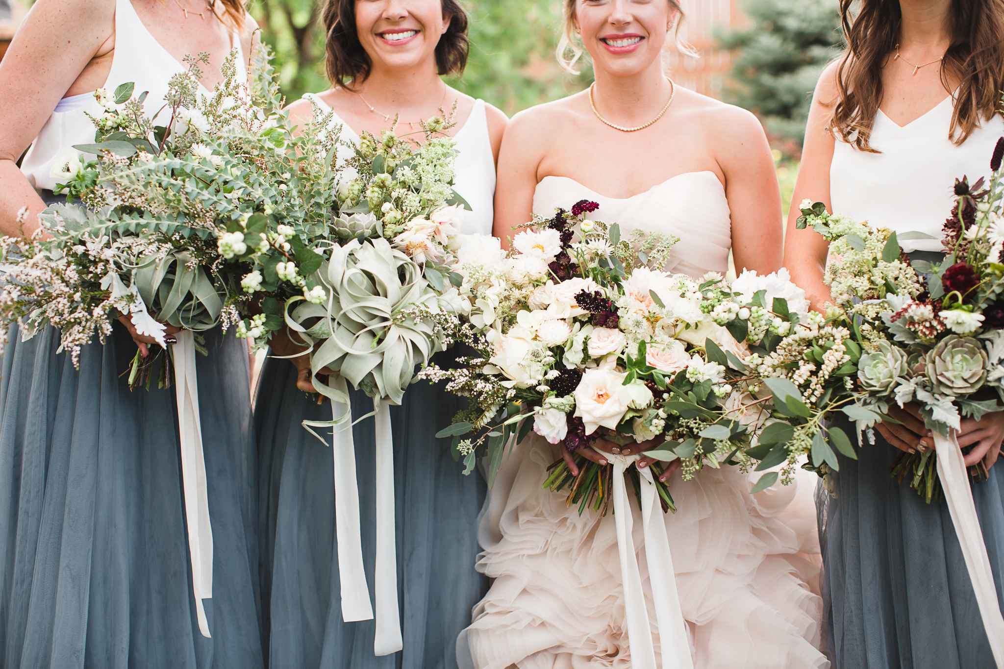 These bouquets by The Daisy Chain are stealing the show in this image.