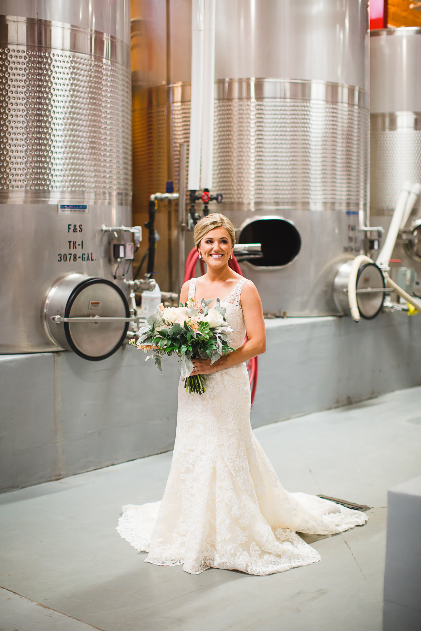 I loved that Amy decided to put her wedding dress on in the wine barrel room of McPherson Cellars.