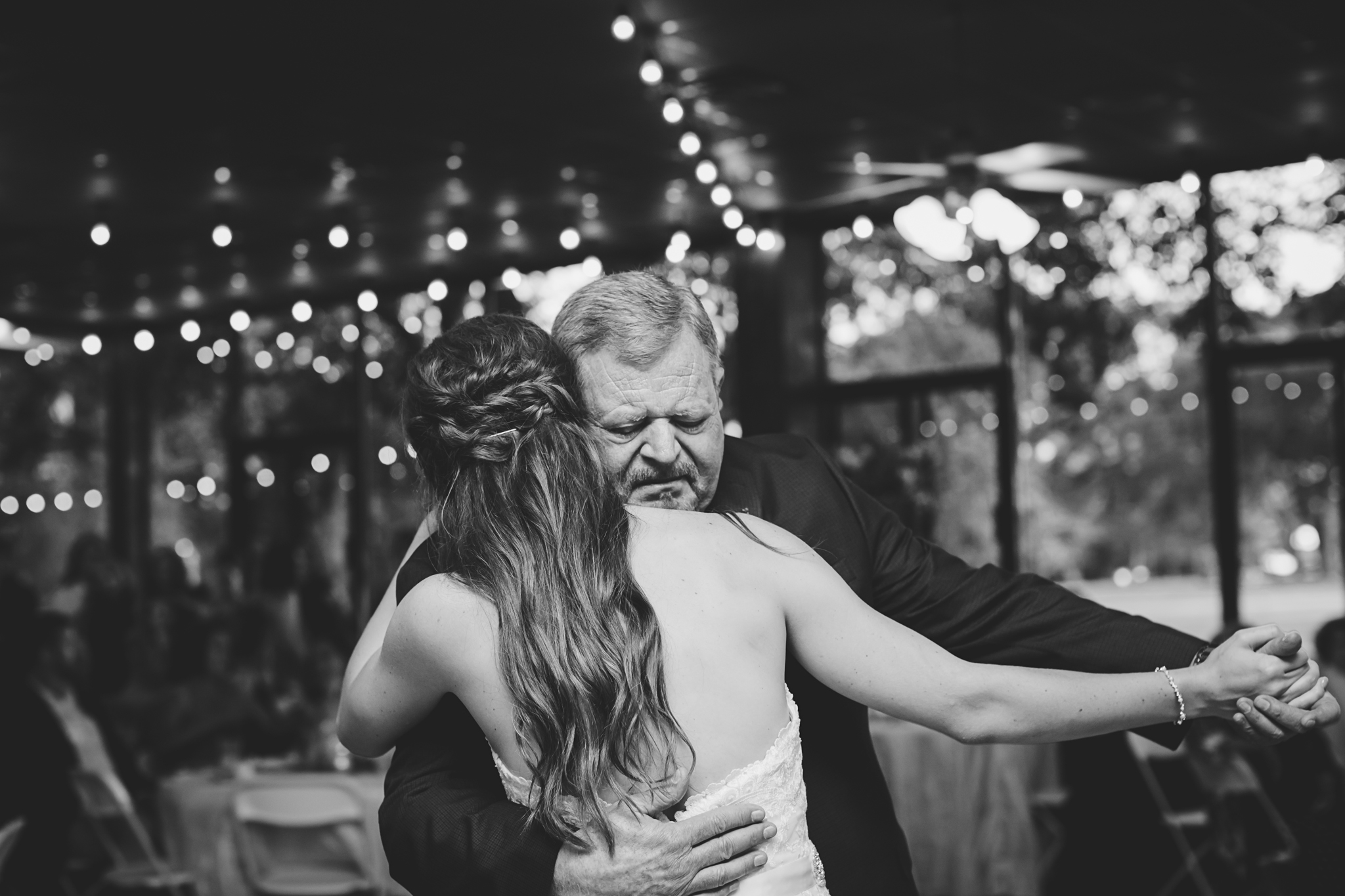 He's letting go of his daughter while holding on so tight.