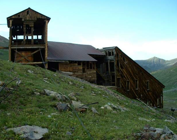 Courtesy of David Singer. The Sound Democrat Mill, thanks to stabilization efforts in the 1990s, now sits intact on a hillside on Placer Gulch northeast of Silverton. Top: The Sound Mill was crumbling before stabilization work.