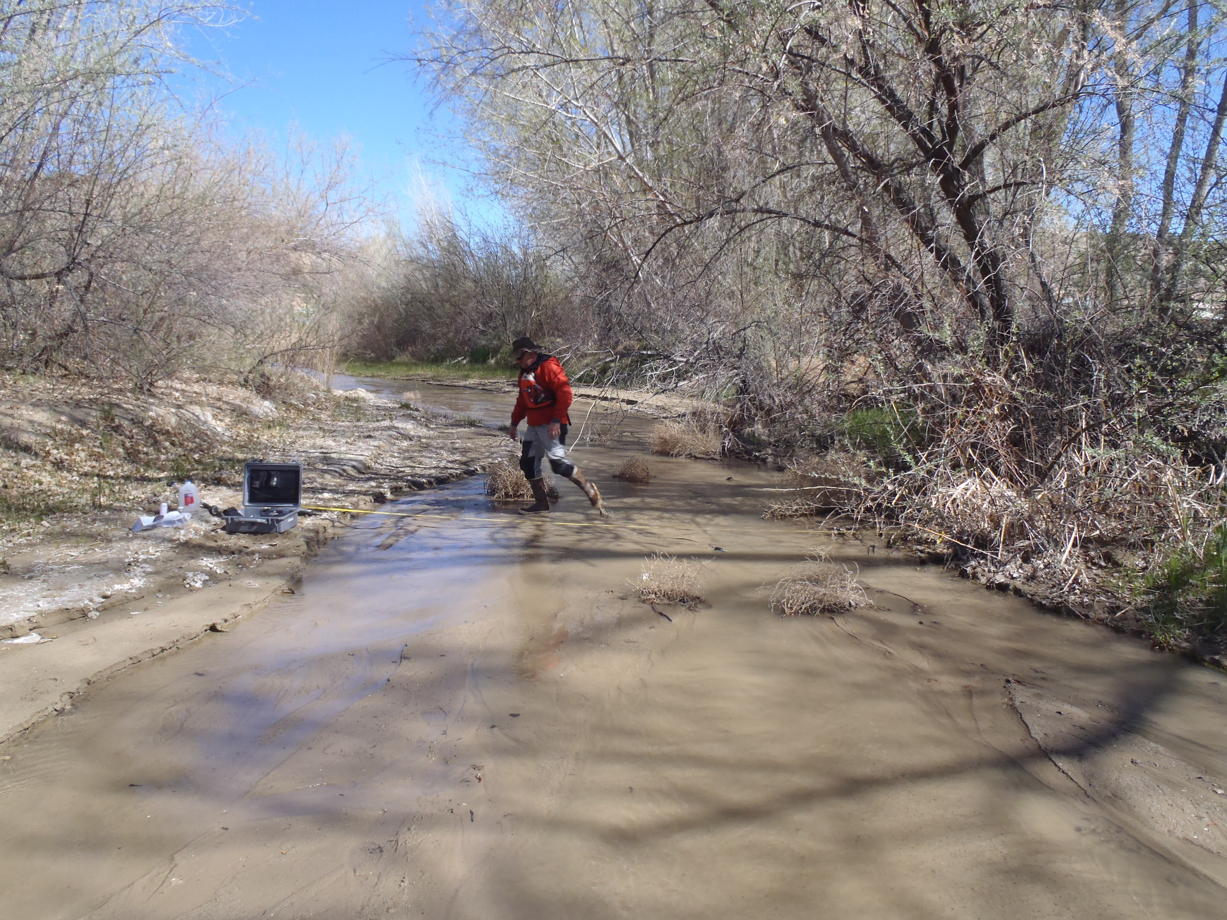 Aaron Kimple measuring flow of an arroyo that inputs to the Animas River near Farmington, NM.