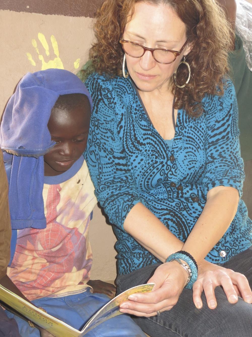 Enoch reads to Nancy: Chikumbuso School, Lusaka, Zambia