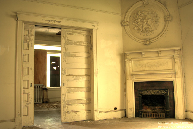 """Above the fireplaces in eight of the Castle's rooms hang 3 ft ceramic medallions from the 1895 Cotton States & International Exposition at Piedmont Park. Each represents a """"cotton state"""" – Mississippi, North Carolina, Georgia, Missouri, Tennessee, Louisiana, Texas & Alabama.  Photo Credit"""