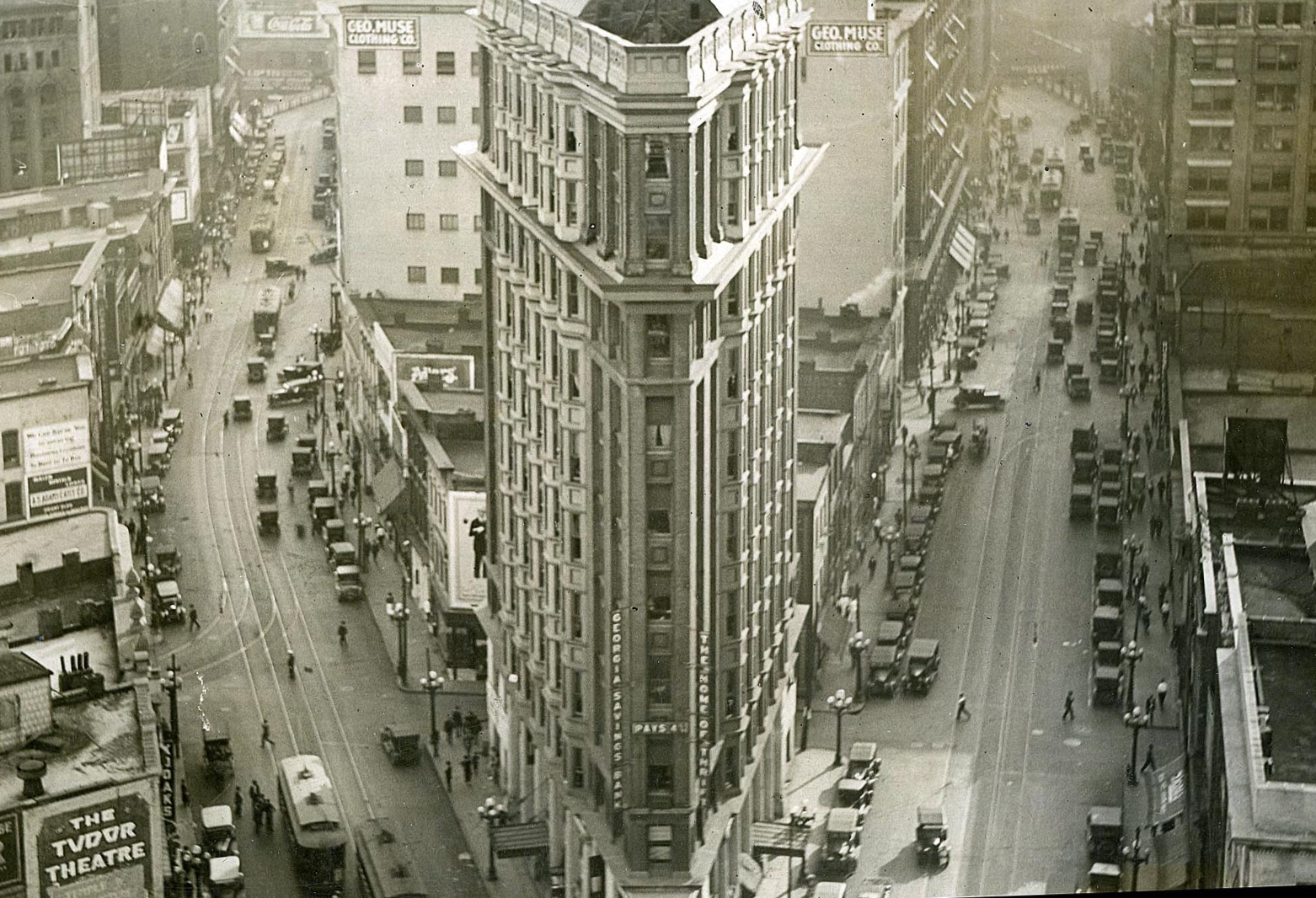 This  1920  photograph featuring the Flatiron Building (also known, at times, as the English-American Building), shows an elevated view looking south.  That's Peachtree Street on the left and Broad Street on the right. [AJC/GSU]