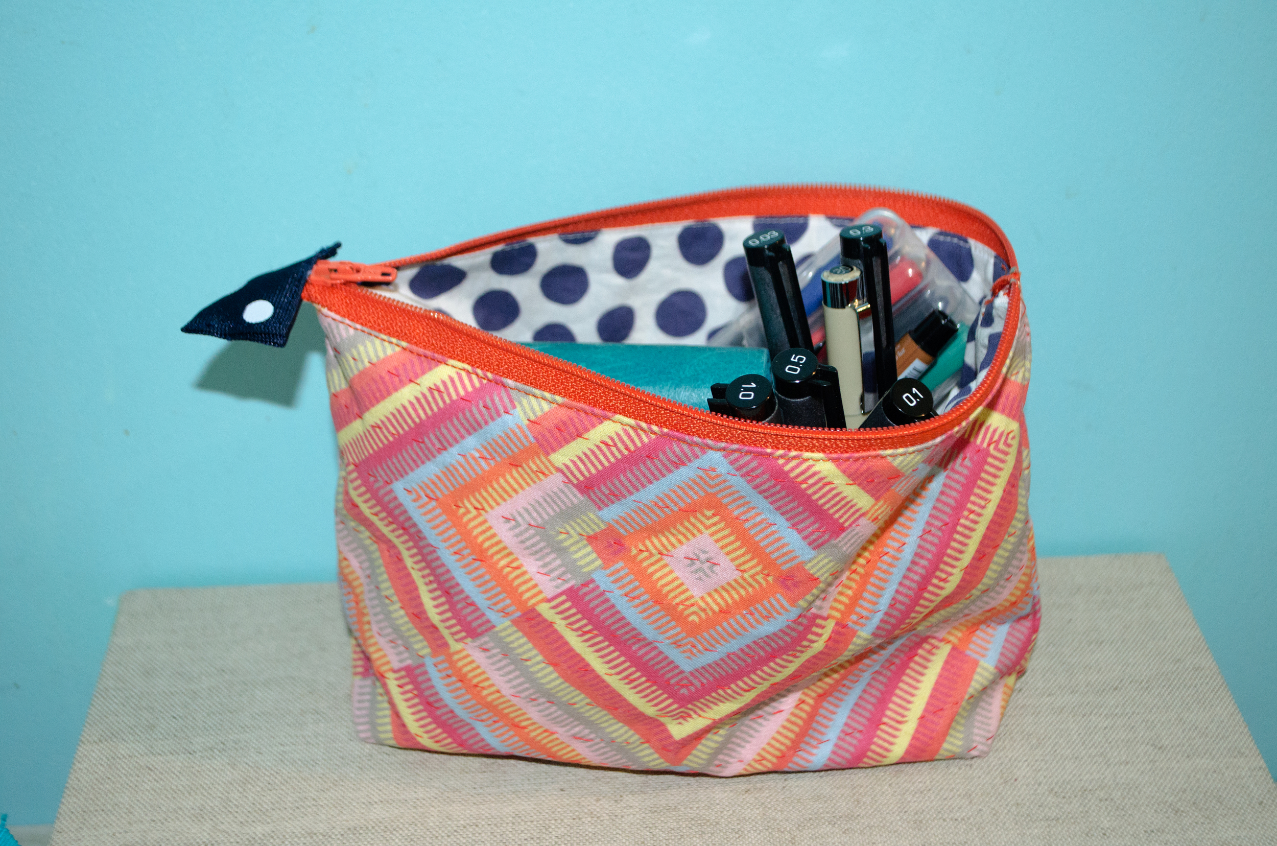 Finished Sprout Pattern Zipper Pouch filled with art journaling supplies.