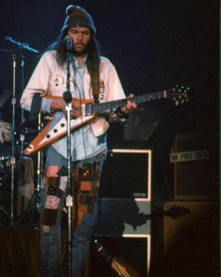 Neil Young wearing jeans patched by his wife, Susan