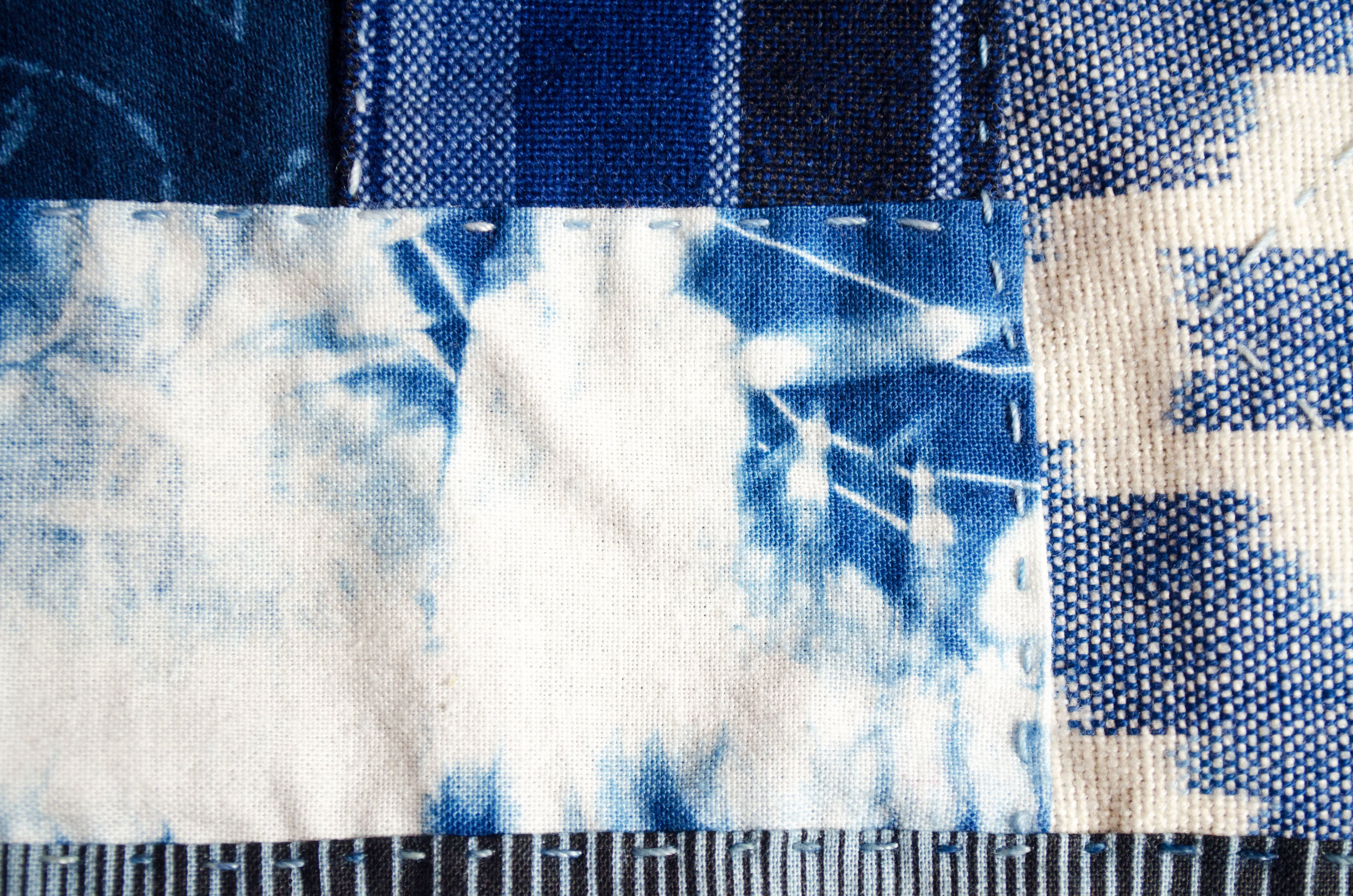 Shibori wrapped cotton dipped in the indigo vat and stitched onto this evolving boro inspired jacket