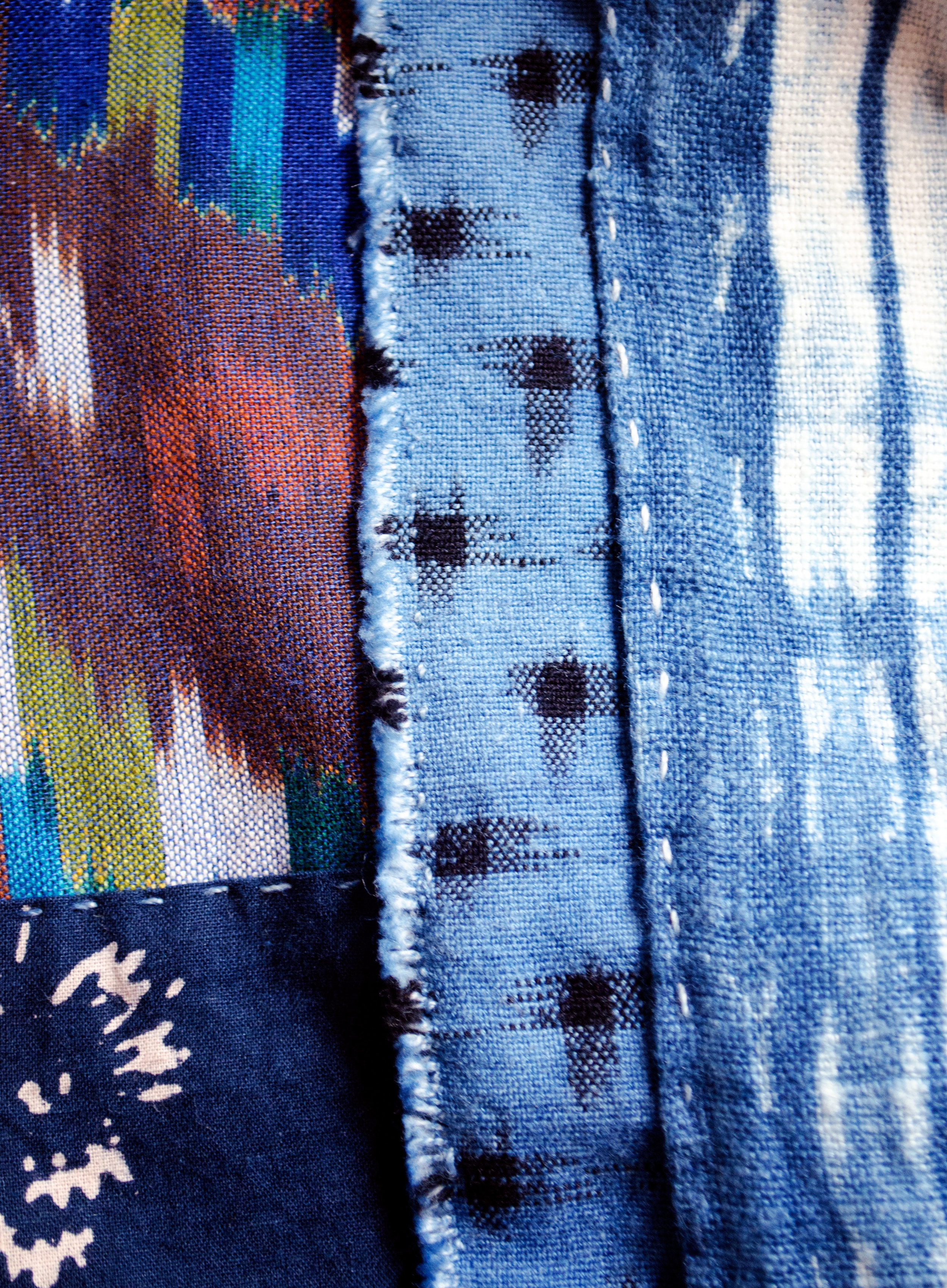 Hand-dyed cottons patched in the boro tradition.