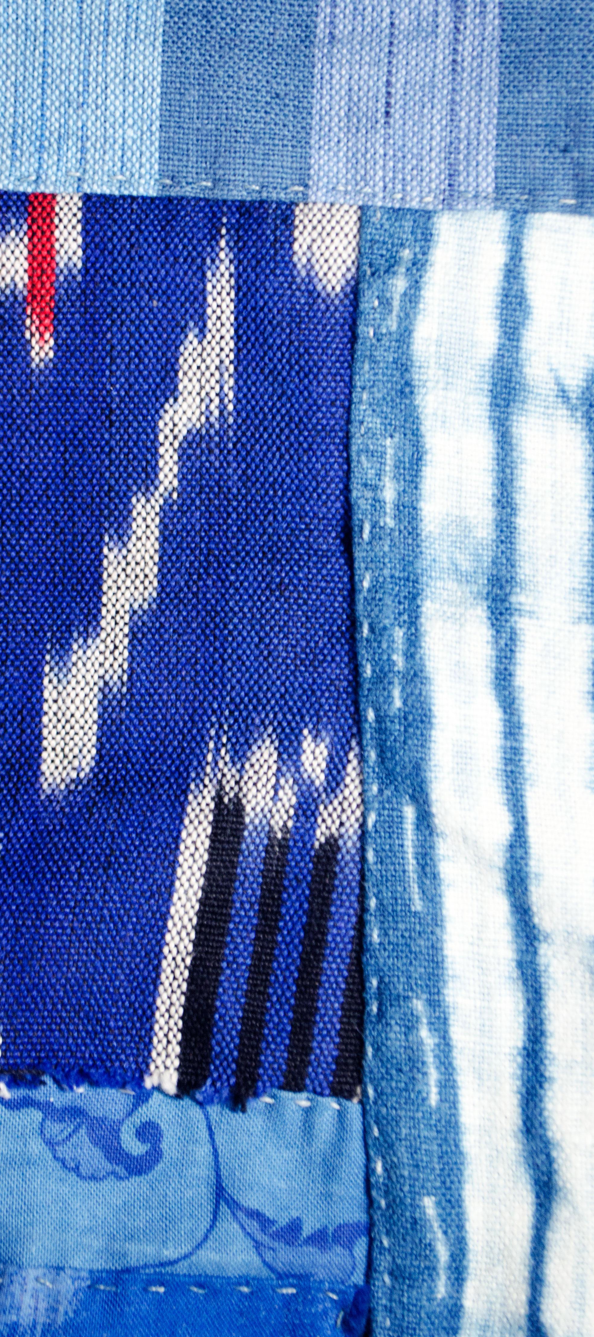 Handstitched shibori dyed indigo linen with ikat woven cotton