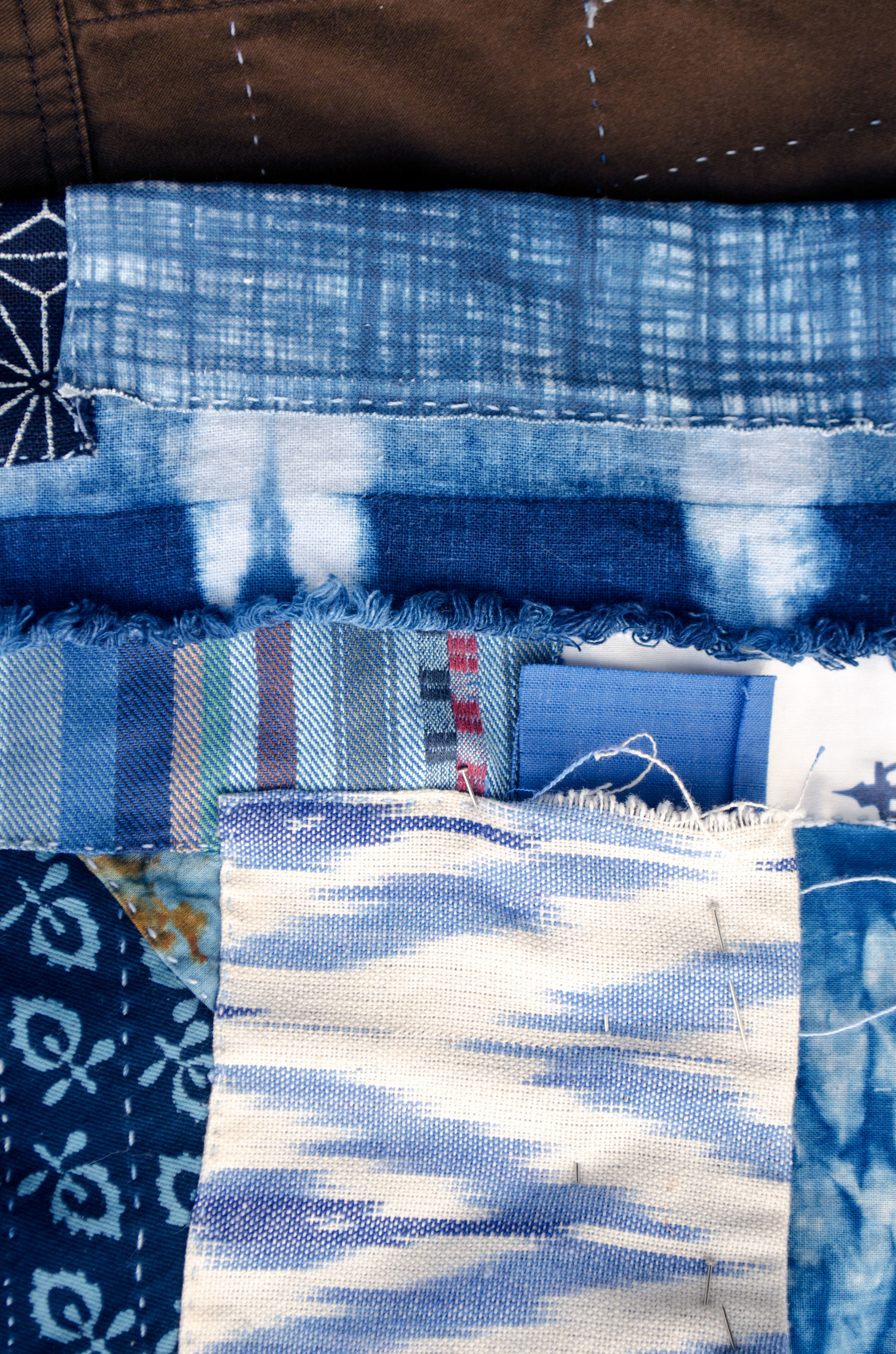 Block printed cotton, ikats, and shibori fabrics patched in the boro style