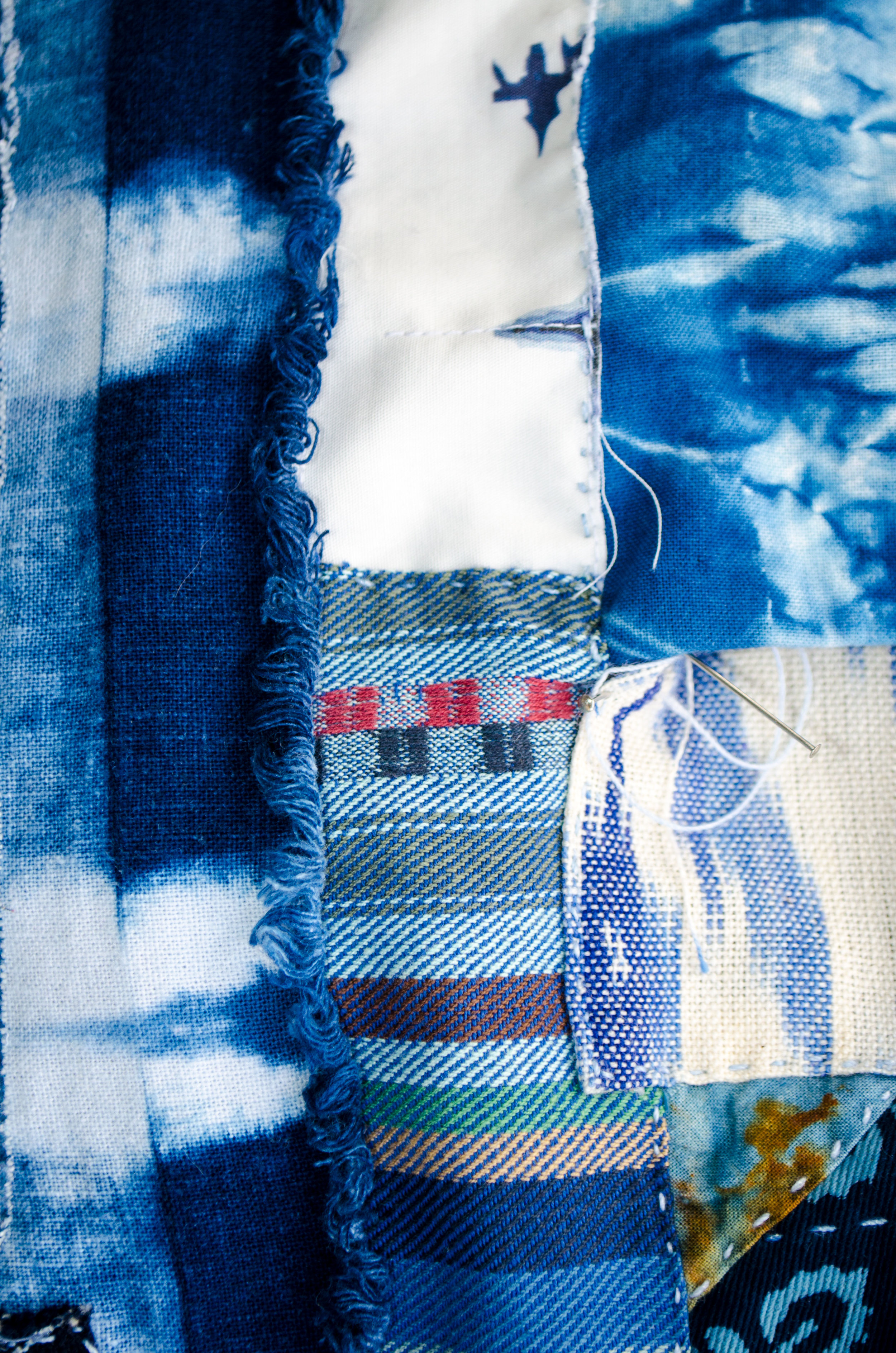 Rust dyed cotton mixed with ikat, shibori and hand loomed textiles