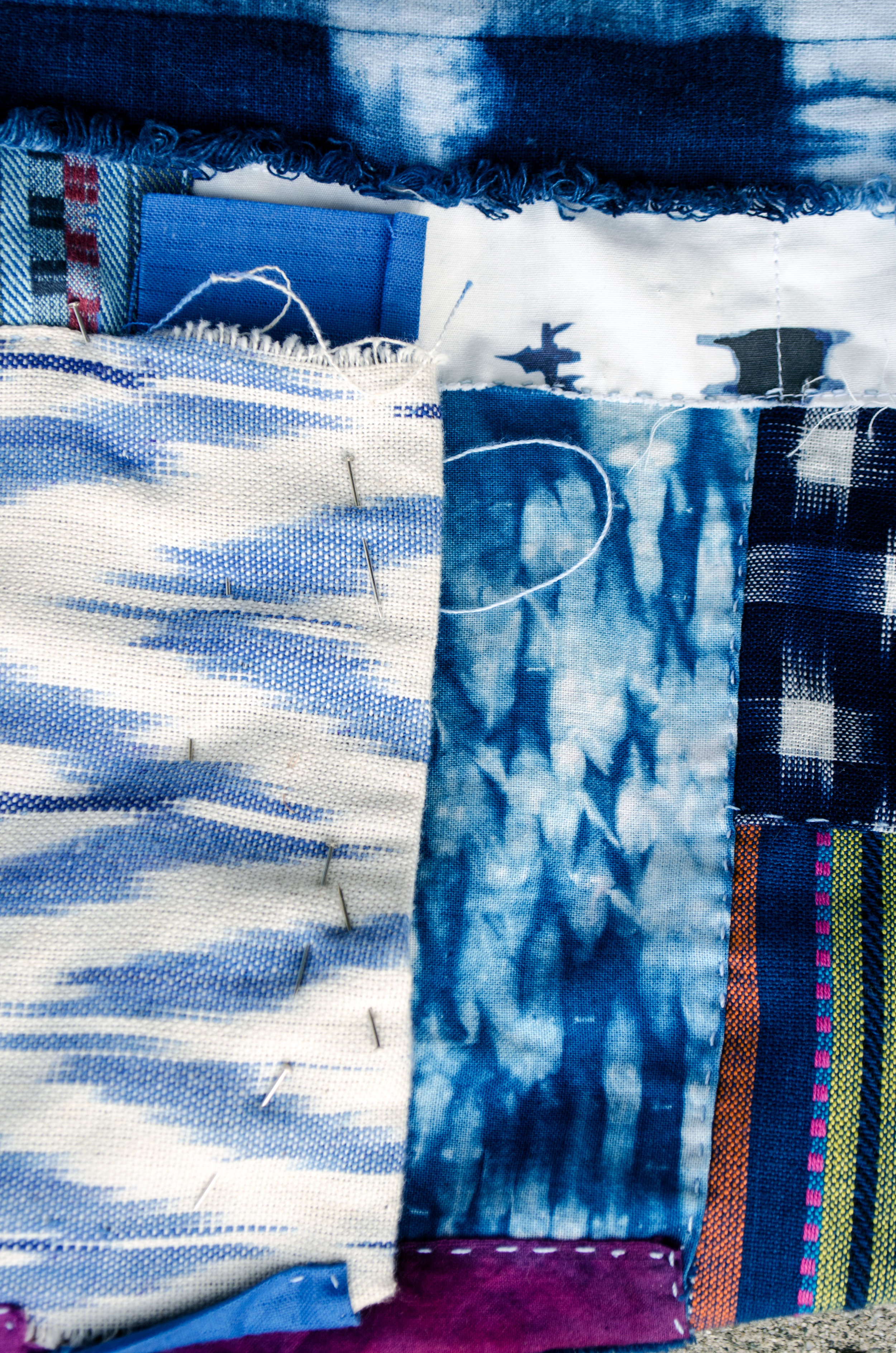 Shibori and ikat fabrics pieced, patched and stitched in the boro tradition