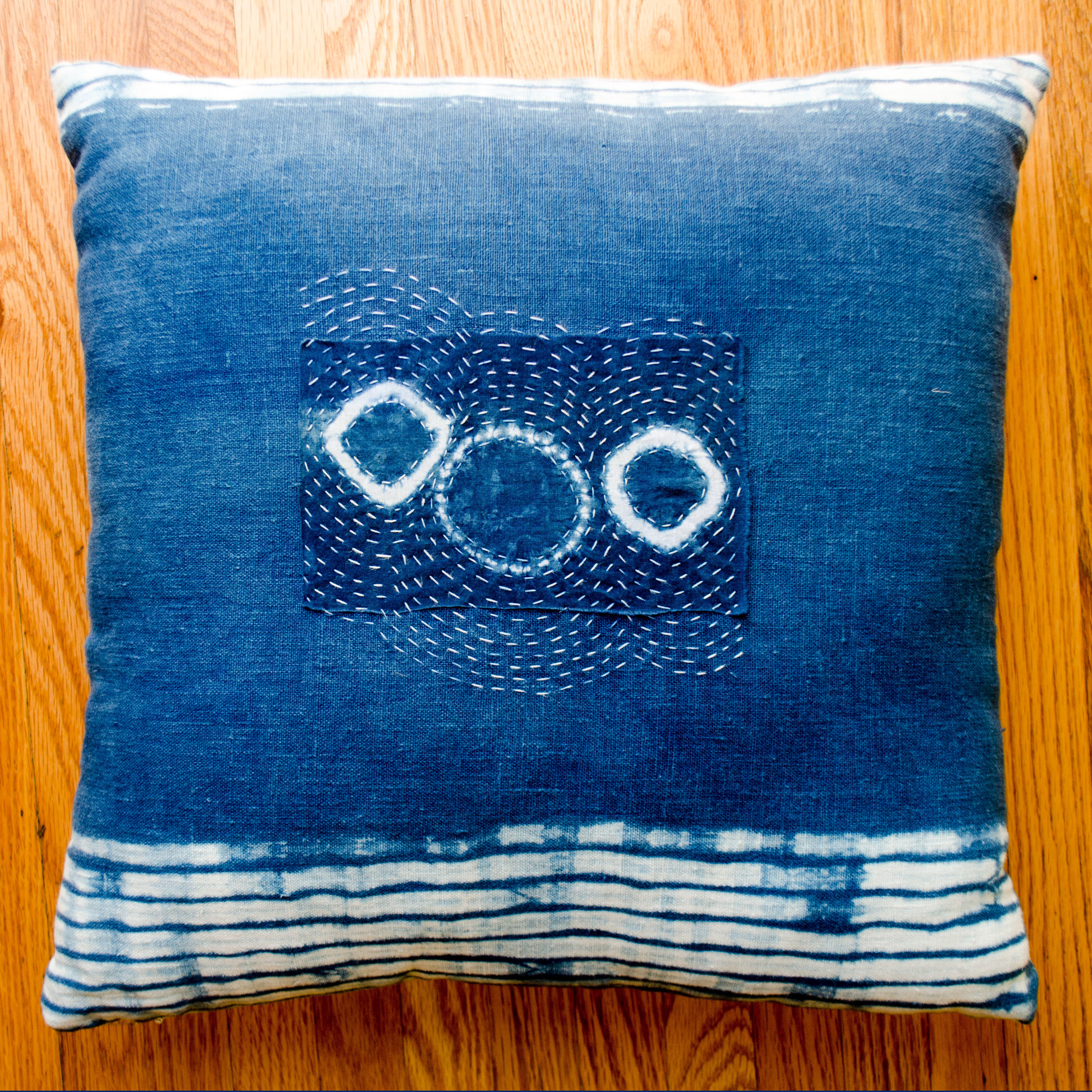 Shibori dyed linen pillow with hand-stitched boro patch