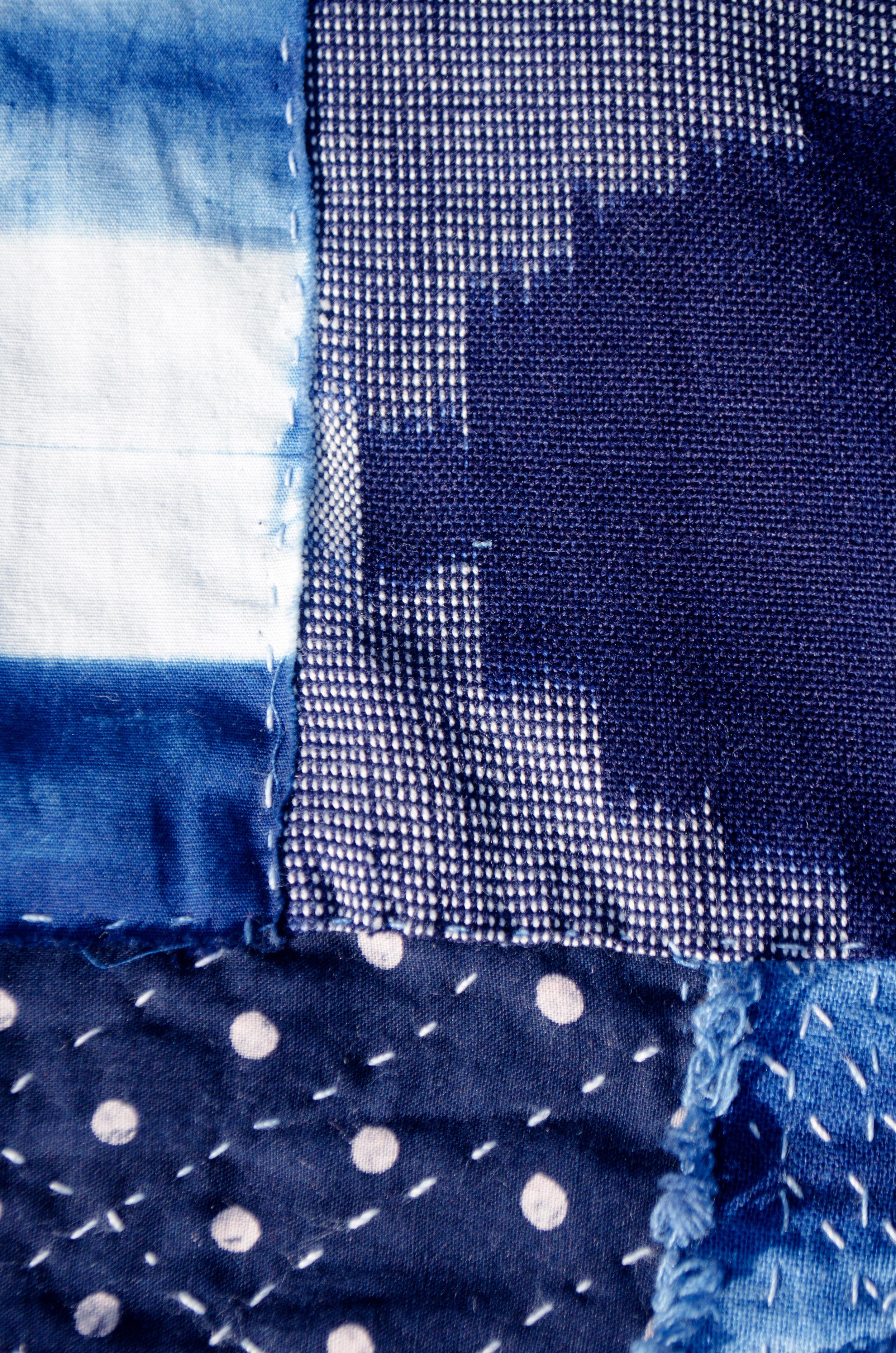 Stitching around resist dyed indigo dots