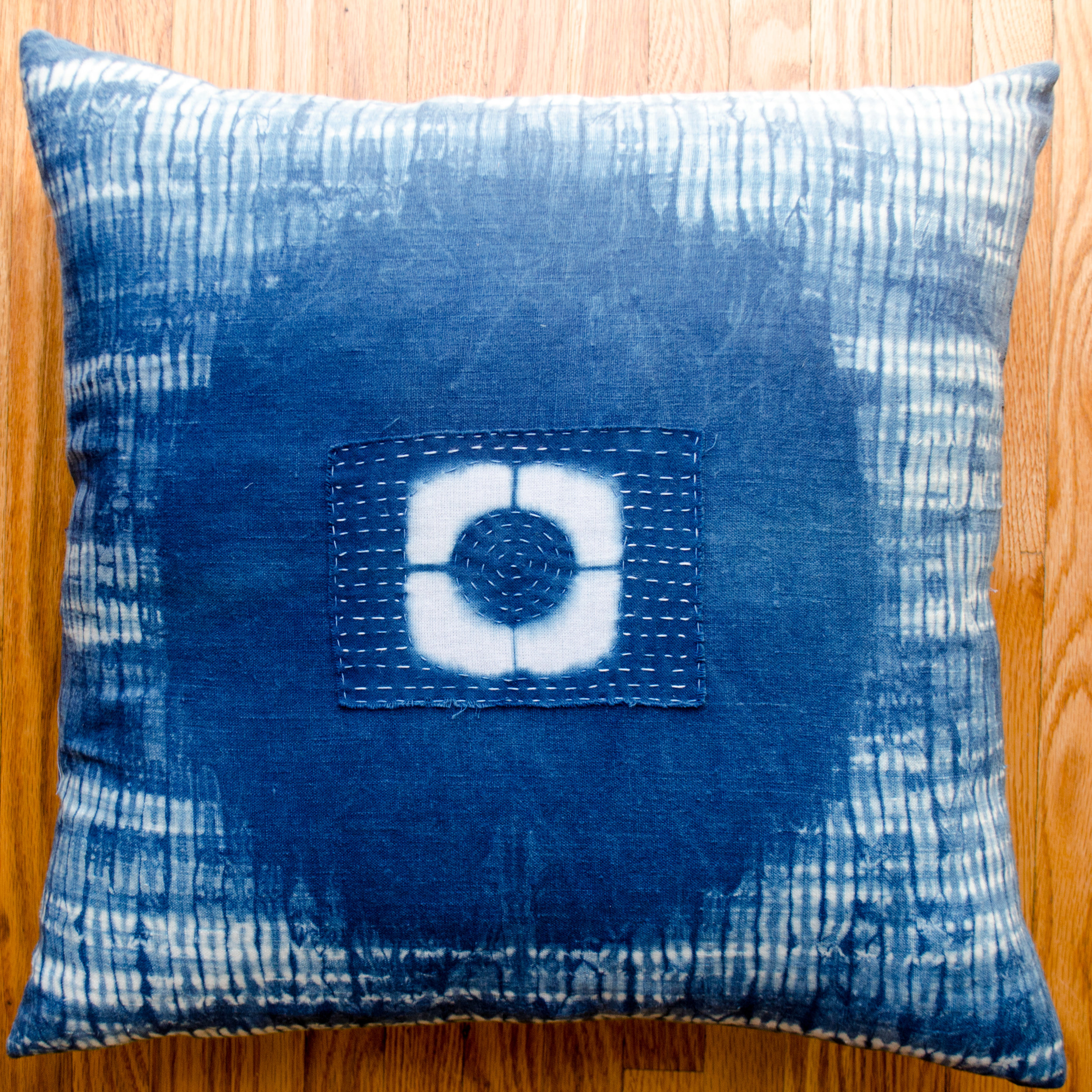 Linen pillow dyed in indigo with a cotton boro patch