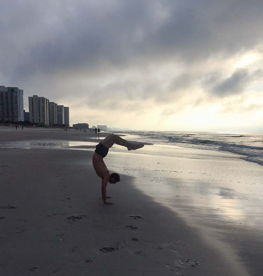 I do a lot of handstands on the beach.