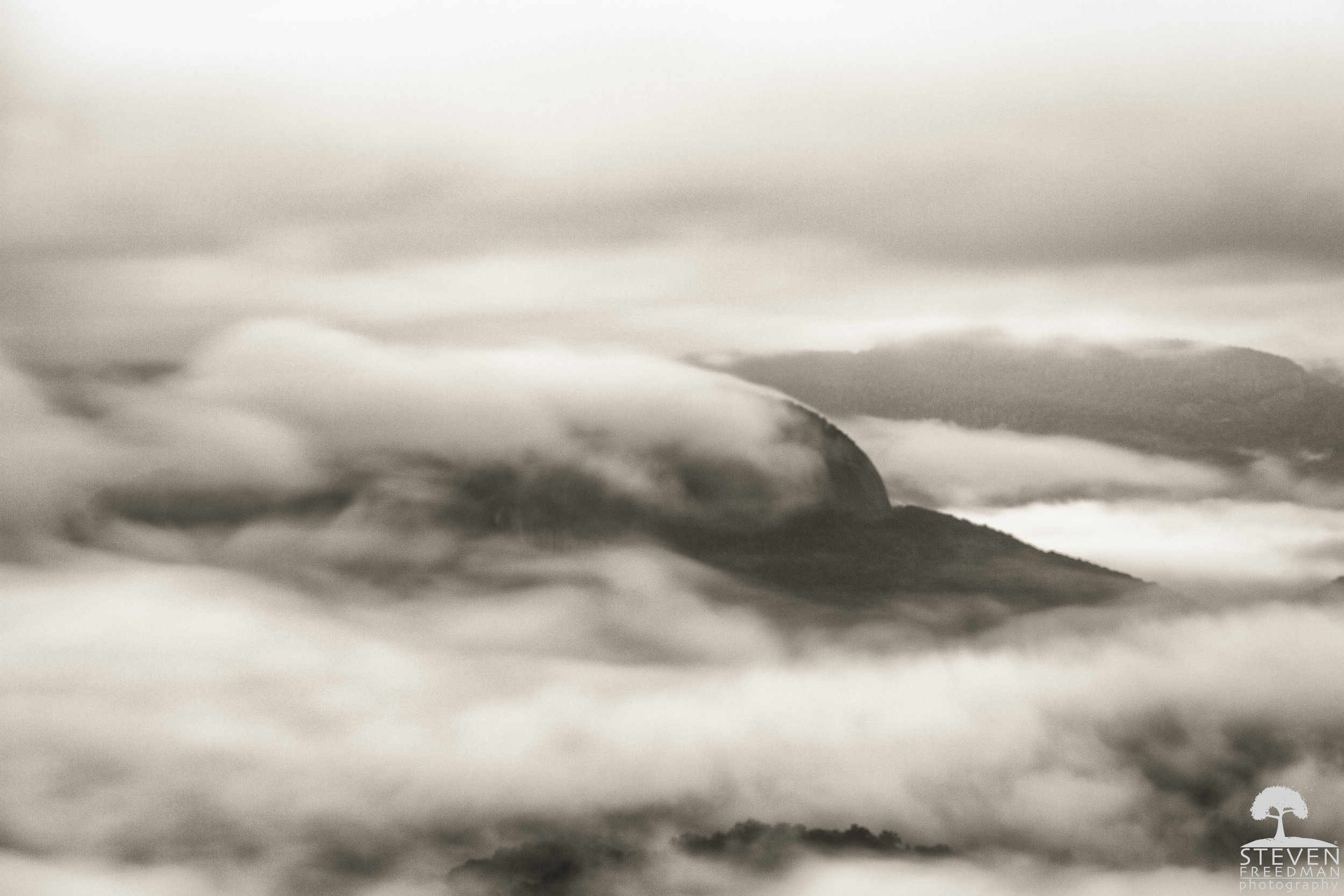Looking Glass Rock Shrouded in Fog (B and W)