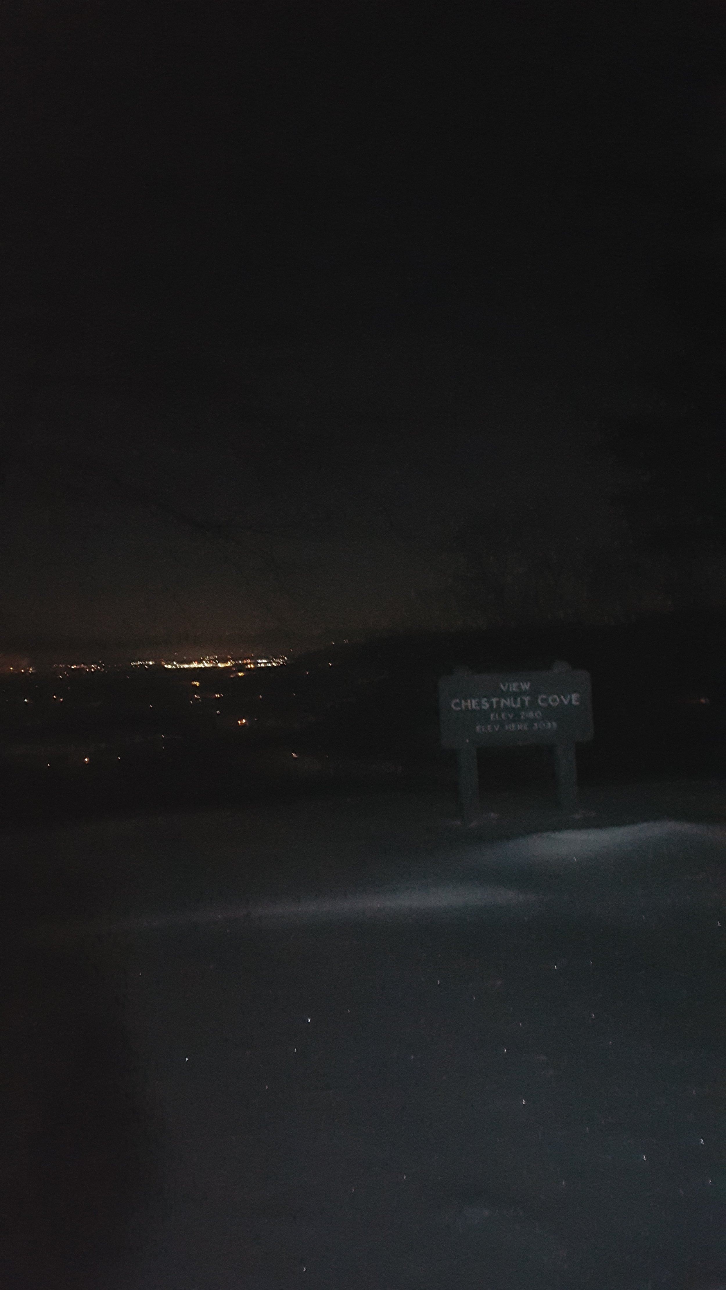 A cell phone shot from the Chestnut Cove Overlook with Fletcher and Hendersonville lit up in the background.