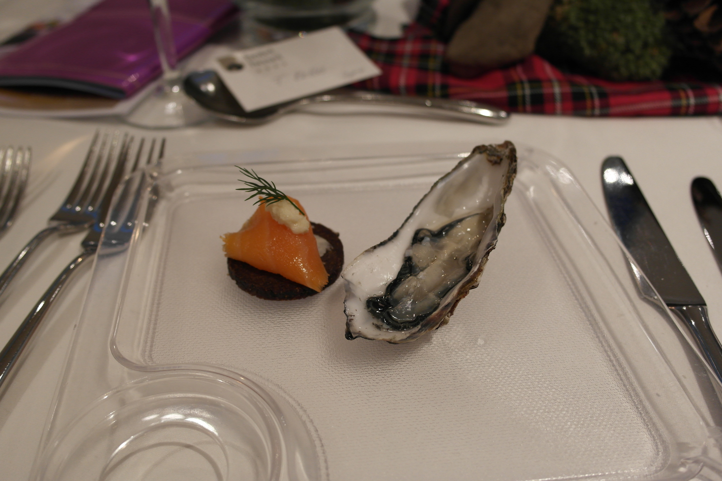 Scottish smoked salmon on dark rye bread and Loch Fyne oysters served with Pinot Blanc Wehlener Kosterberg Islay Cask 2012, Markus Molitor