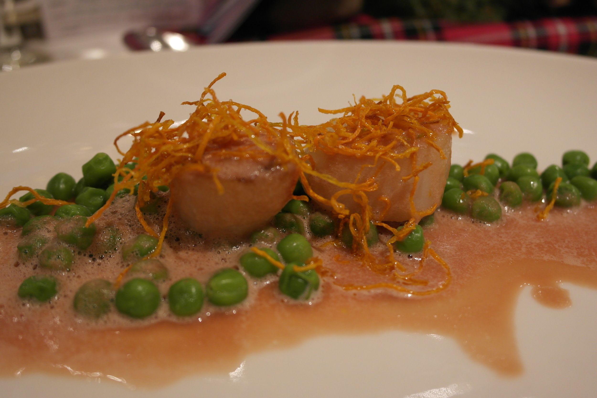 Duet of red beet and peas with scallops on carrot straw served with Single Malt WK 499 Old Pulteney