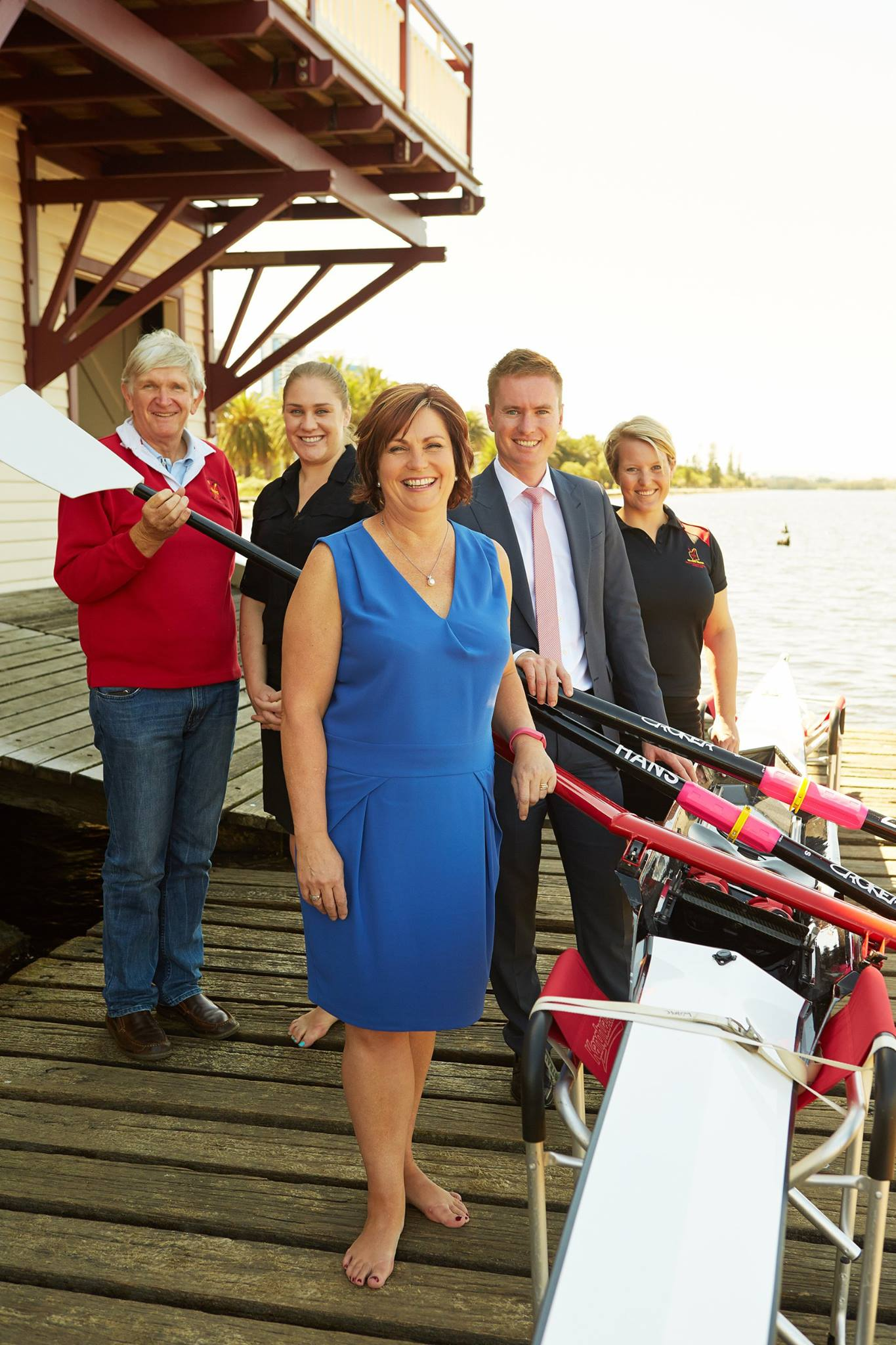"From left: WARC Life member Clem Williams, Vice President Jessica Donnelly, Heritage Council chair Marion Fulker, Heritage Minister Albert Jacob and WARC President Peta Rule with the ""Wimmera"" MQR single scull and Su Guy's ""Hanz Off"" Croker oars."