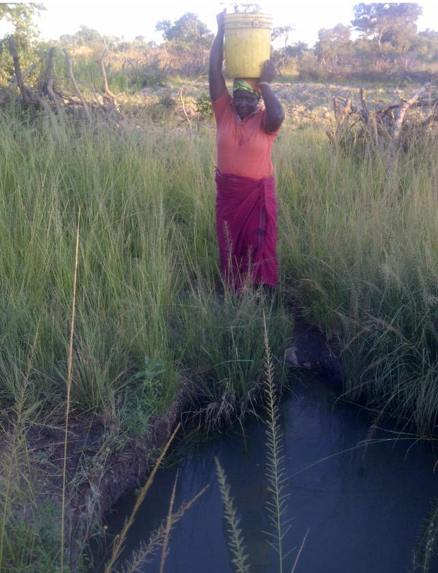 Preparing to walk water back to the family. Siachihja, Zambia.