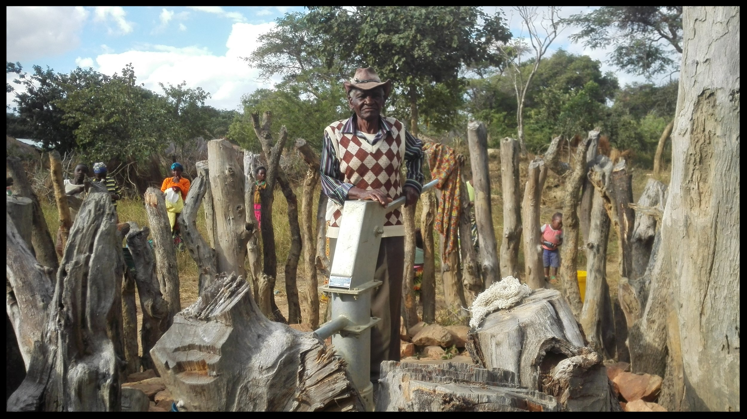 The wells built in Zambia have a hand pump (pictured). The village work together to build a fence around the well to protect it from wildlife and livestock. The village forms a committee to take responsibility for well maintenance. The man pictured here is the Elder of the Sibalwa well committee.