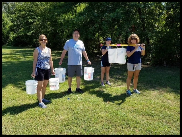 Participants of the 2017 Water Walk carry water to raise money for clean wells in Zambia.