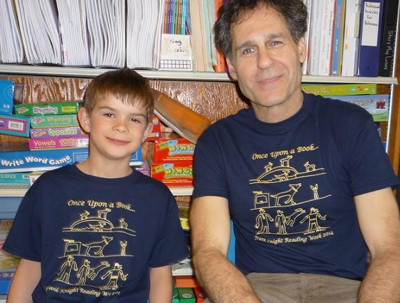 Posing with the second grader who designed the T-Shirt everyone wore the day of my visit!