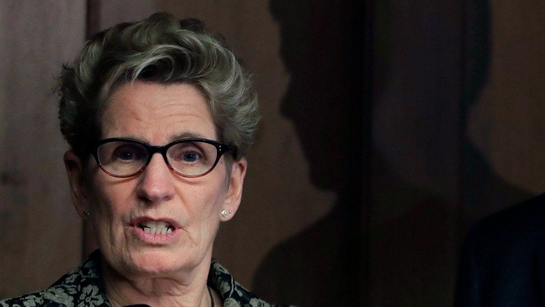 "Kathleen Wynne's government plans to retaliate against U.S. states that adopt ""Buy American"" policies. (Carlos Osorio/AP)"