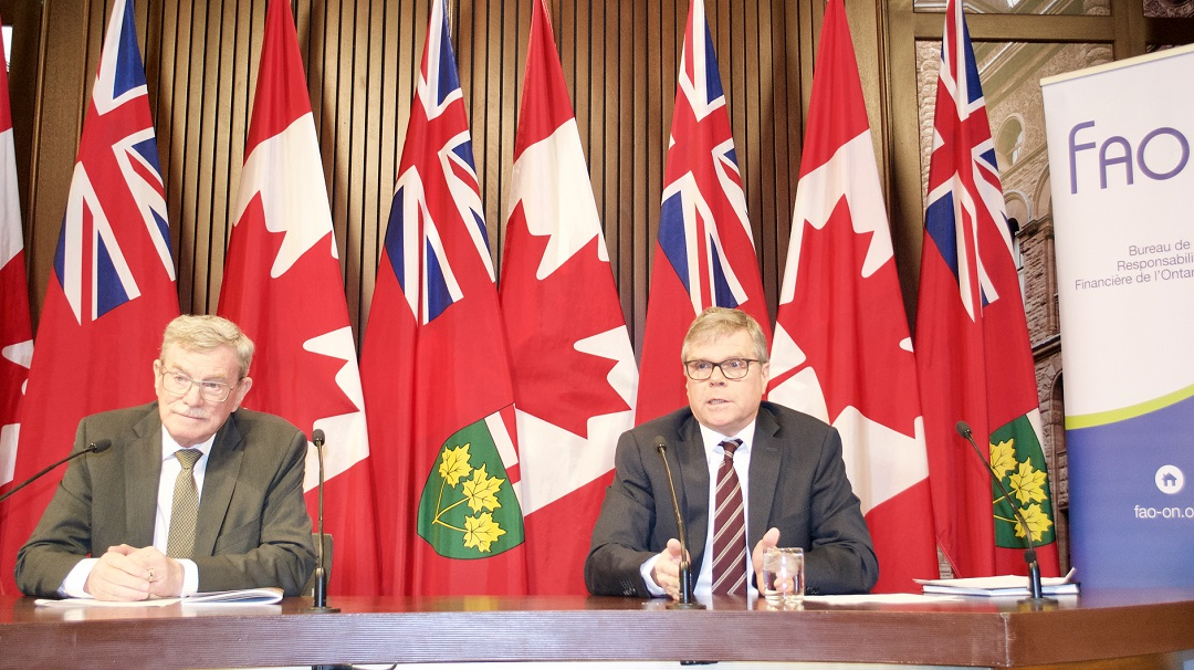 David Wake (left) and David West presented the Financial Accountability Office's 2017 fall economic and fiscal outlook at Queen's Park on Monday. (Sarah Reid)