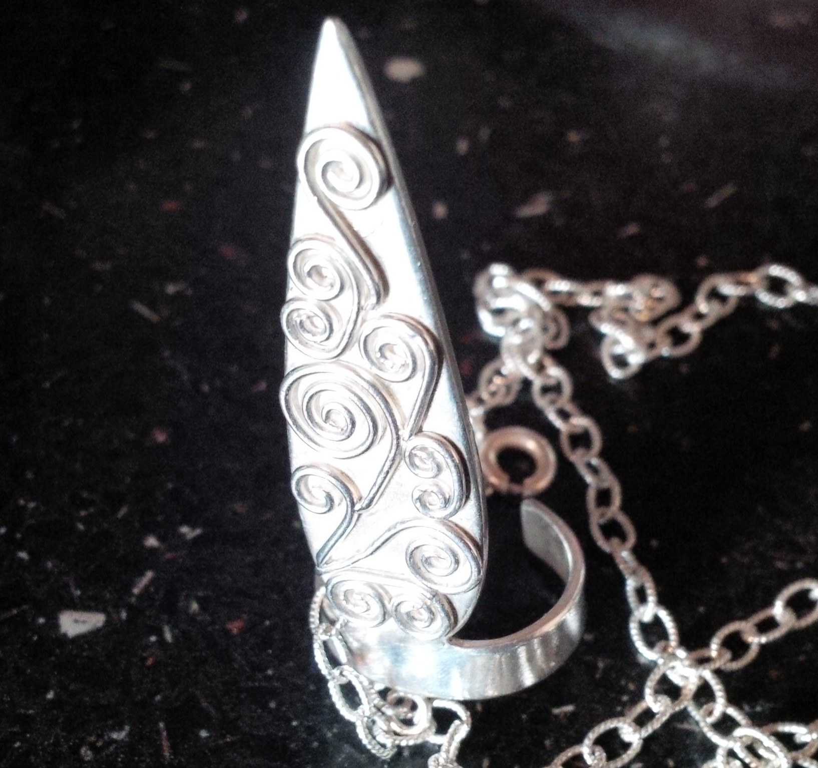 Pointed joined ring and bracelet with wirework detail