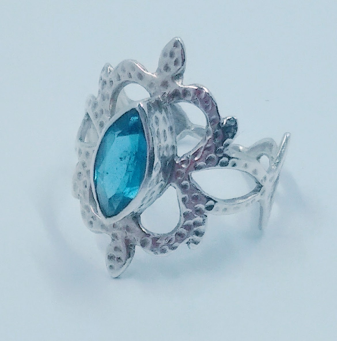 Silver textured, hand-carved ring with large, marquise cut London Blue topaz