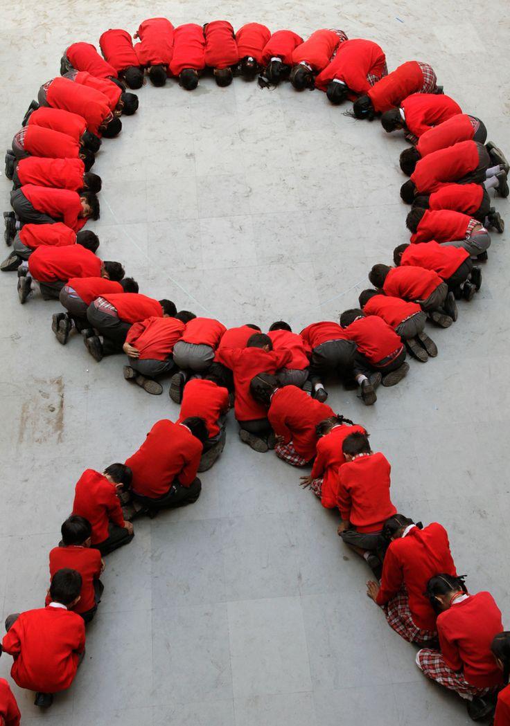 The red ribbon is the universal symbol of awareness and support for those living with HIV/El listón rojo es el símbolo universal de apoyo a la lucha contra elsida y solidarización consus víctimas.