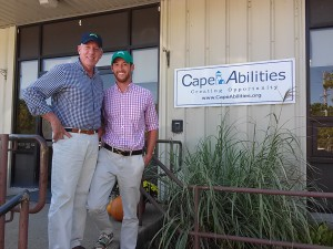 """CapeAbilities President Larry Thayer and Cape Cloth Founder Sean Fitzpatrick wearing """"hats that give back"""""""