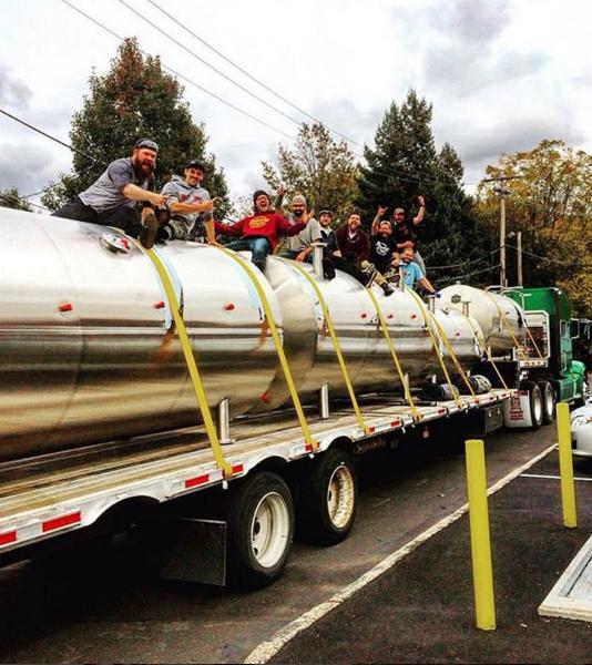 Neshaminy Creek Brewing Company crew with their horizontal lagering tanks.
