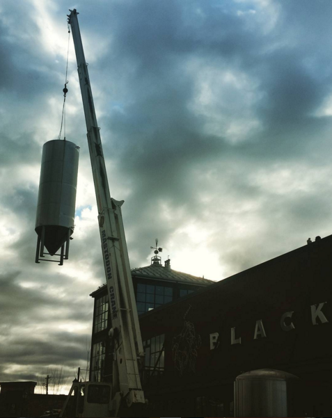 A 100BBL Fermenter being installed at Great Northern Brewing Company.