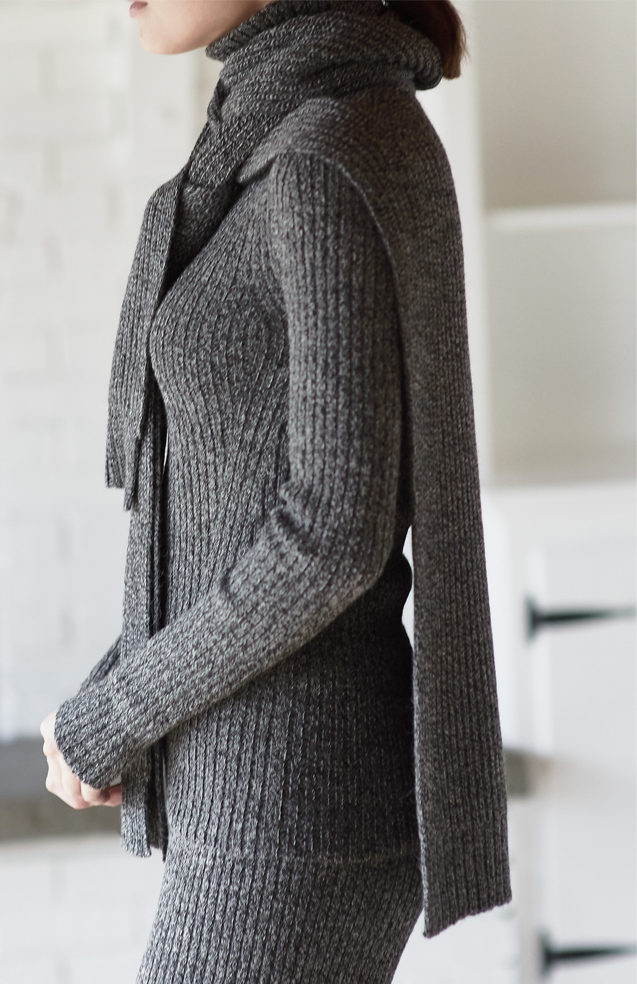 Combining contemporary design with traditional Andean knitting techniques, Eleven Six      knit dressing. As a mother, wife, and entrepreneur, Catherine designs for the modern woman in need of a versatile wardrobe to suit a lifestyle   of work, travel and play. Inspired by Peru's rich heritage of craftsmanship in textiles, with modern     Alpaca yarns. Worn alone or mix and matched     a relaxed femininity that is underscored by a signature neutral palette. Accented by seasonal tones, creams and a range of grey melanges, from the palest moulin to the darkest graphite, are accompanied by rich oatmeals and camels.