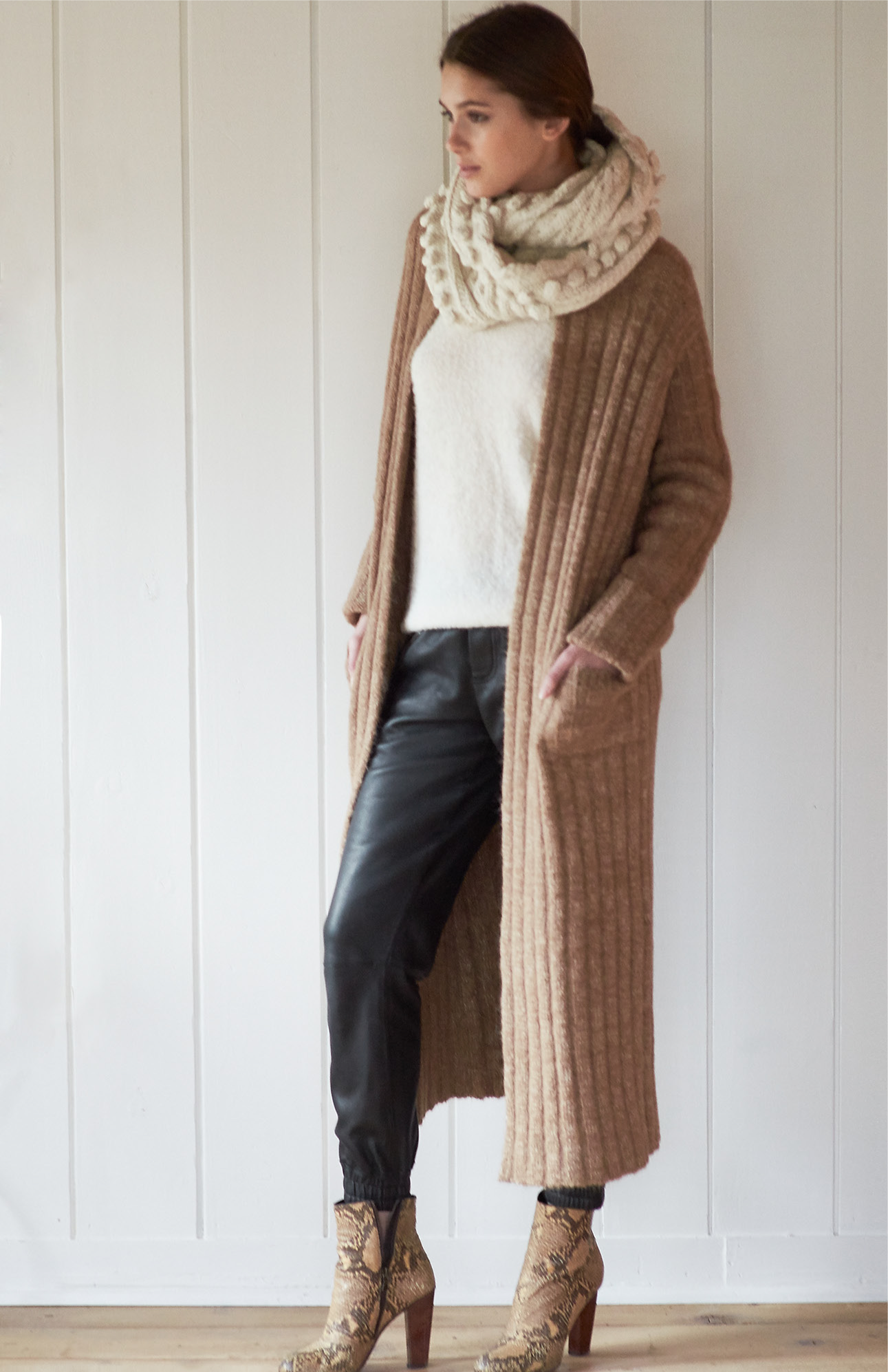 Intended to be worn crossseasonally, the core neutrals allow the Eleven Six woman to compose a wardrobe that allows for just that. A favorite of Catherine's, the essential Lulu Wrap is      making for the perfect everyday companion.  Eleven Six exclusively uses yarn that is natural, sustainable, ecofriendly and ethical.     The Alpaca yarn is developed   to   withstand the cold as well as the equatorial warmth. Very simply, that means that Eleven Six collections span the breadth of all seasons, keeping you warm in the winter and cool in the summer.