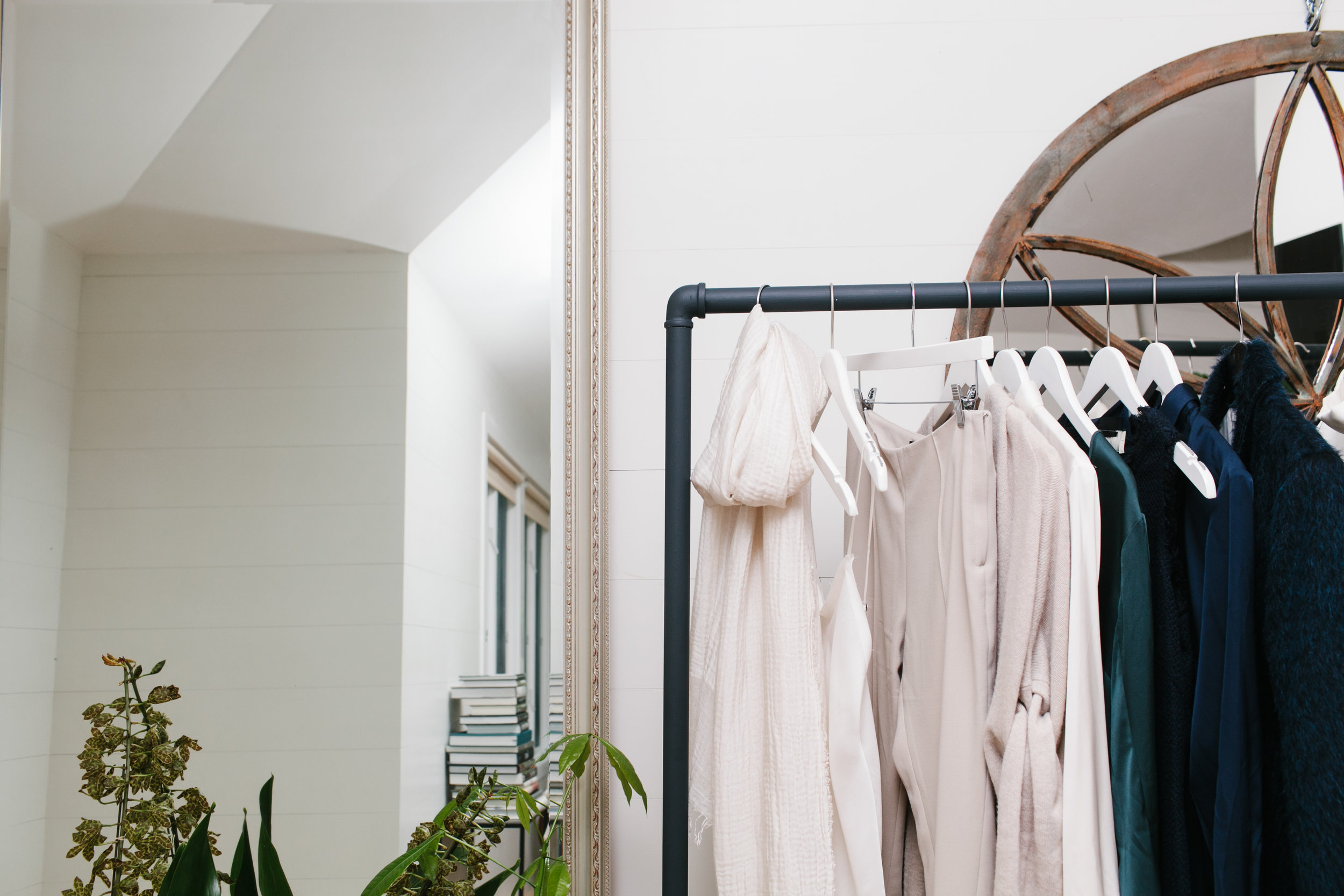 I am in the fashion business, and run my own business from home sometimes, which means that clothing racks and rails are part of my stock and trade. I decided to abandon the bright reflective steel once and for all and use  Railings  to give the racks class, presence, a graphic quality. Perfect.