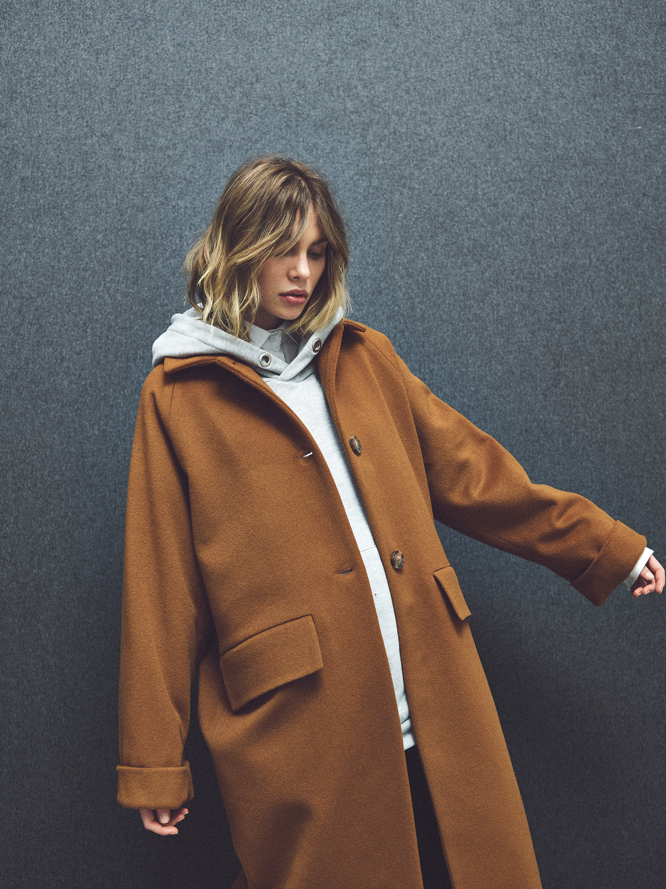 """MARGAUX LONNBERG  Often times a designer and their creations can make a woman feel both powerful and comfortable. And that sensation can be as much about the juxtaposition of materials as it is the contrast of color. For instance, an oversized cotton hoodie in light grey strikes a good natured contrast with a wool overcoat in burnt sienna. Works flawlessly in the modern marketplace -- it's very of the moment,yet with an elegant style. I've always thought that a strong coat or blazer paired with comfortable sweats gives off that subtle wink of a """"boyfriend's borrow"""" under a layer of pure self-knowledge and femininity. That's a seductive combination."""