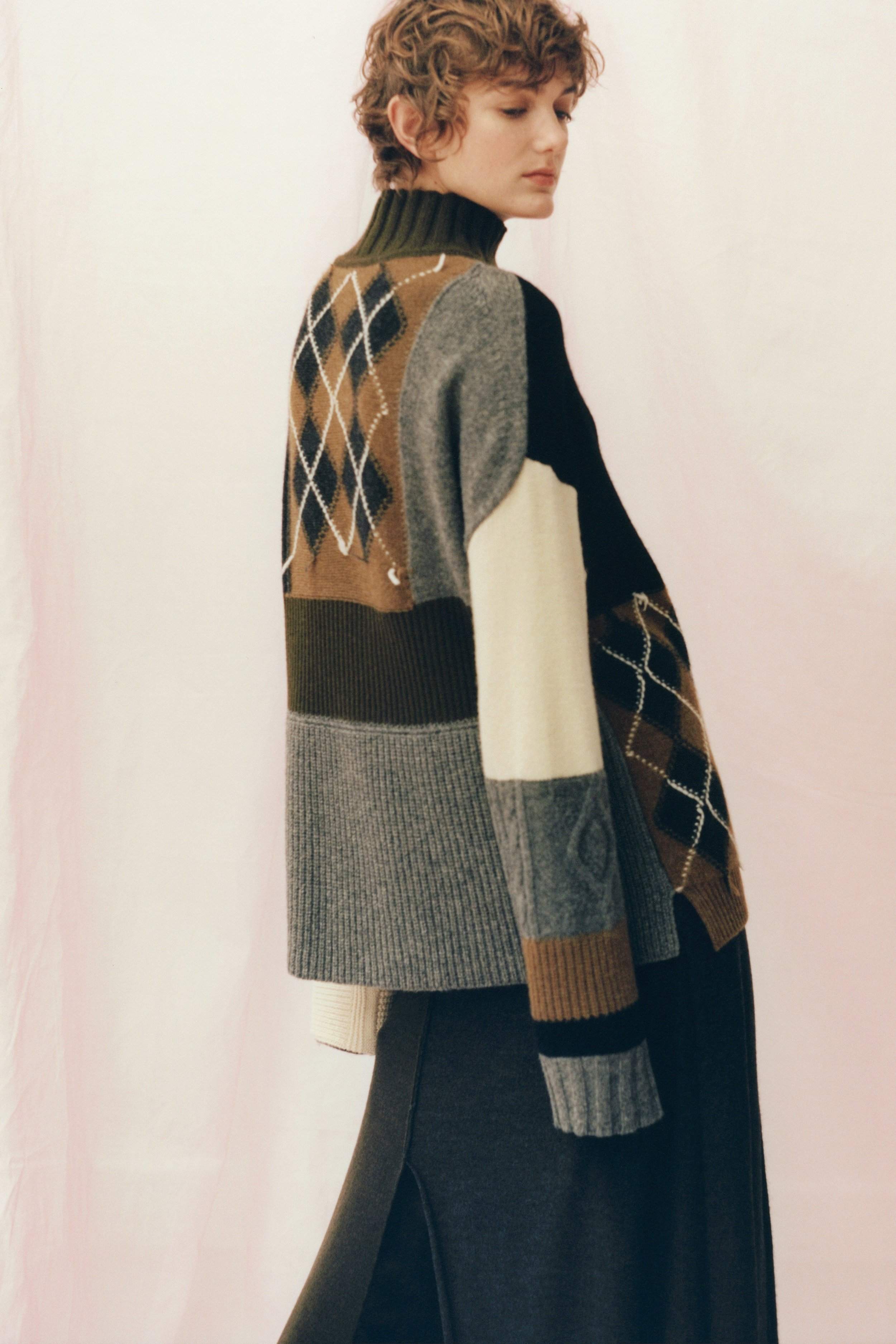 From the archives of Pringle of Scotland, classic patterns are woven together to form this vintage patchwork sweater.