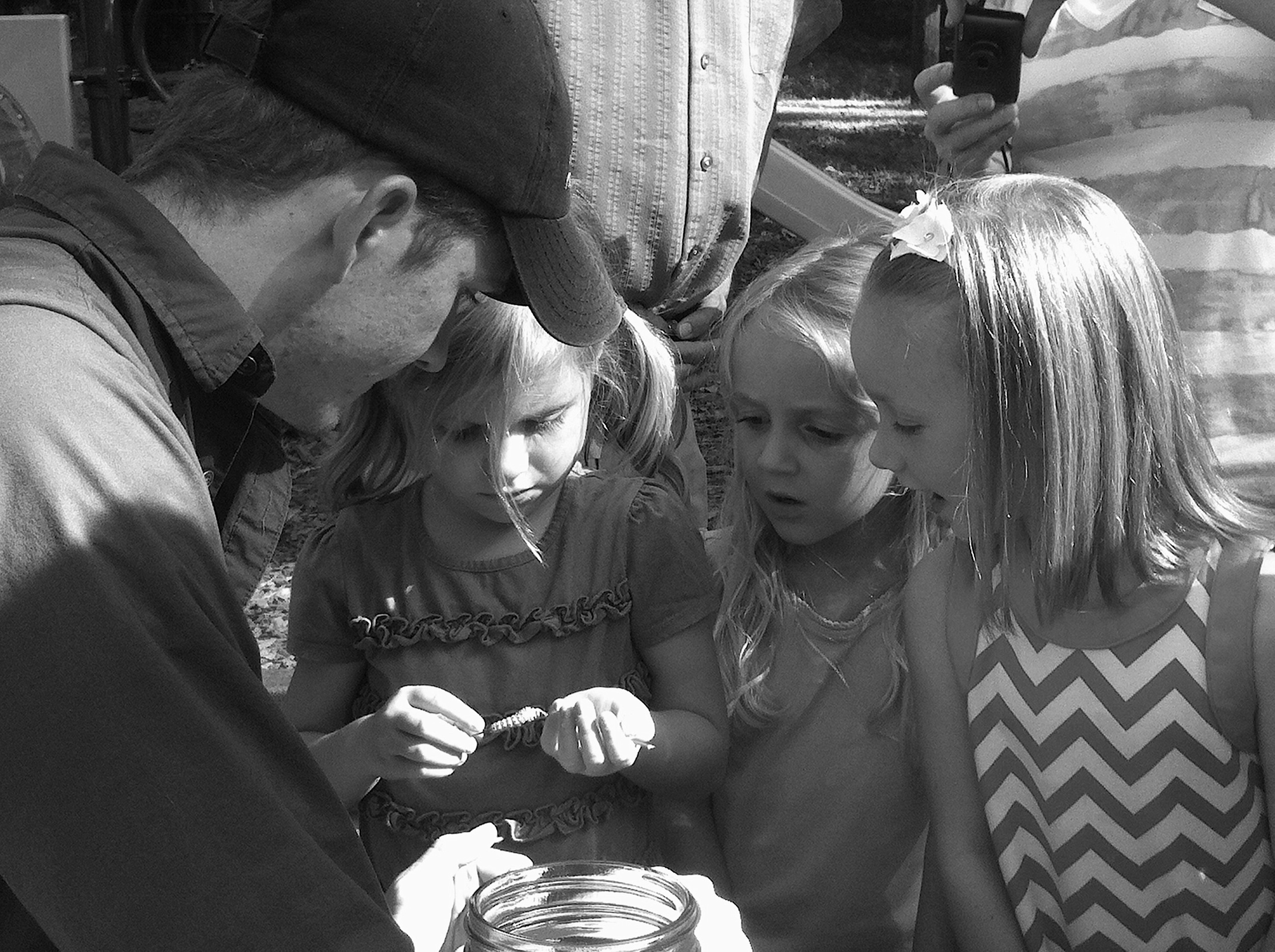 Holding live butterflies at a bug themed birthday party.