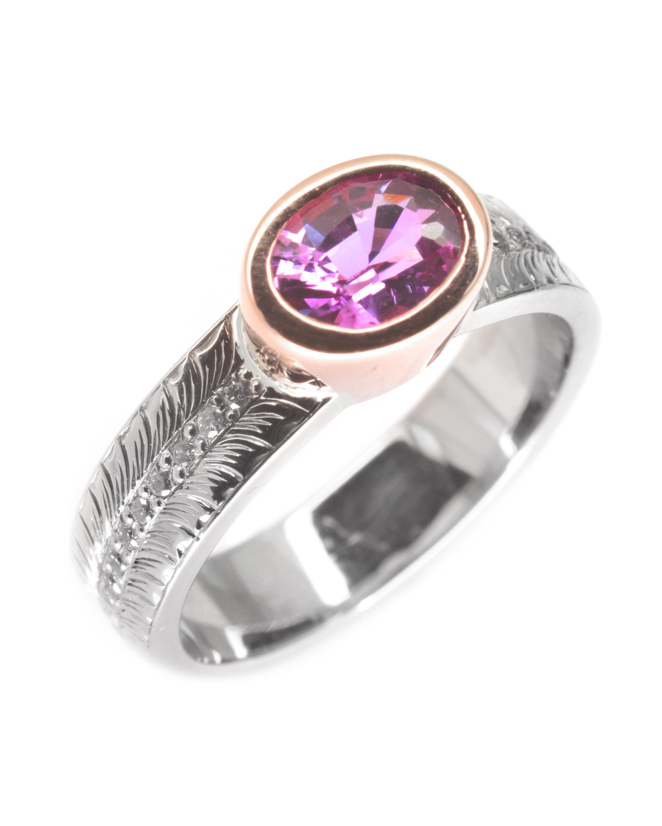 14k white and rose gold ring set with a pink spinel with hand engraving, designed by Jason Baskin and engraving by Darren Demarco.